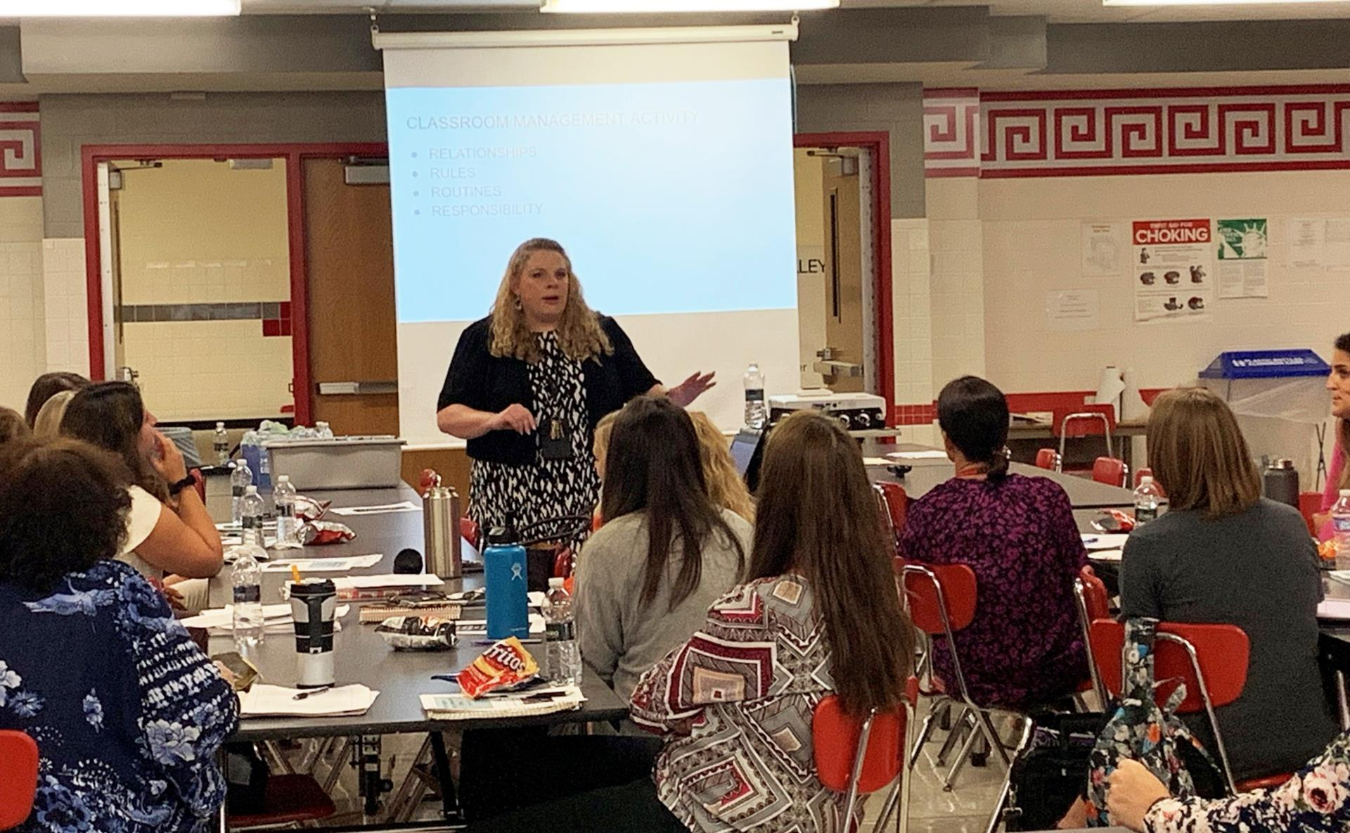 Assistant Superintendent speaking with teachers