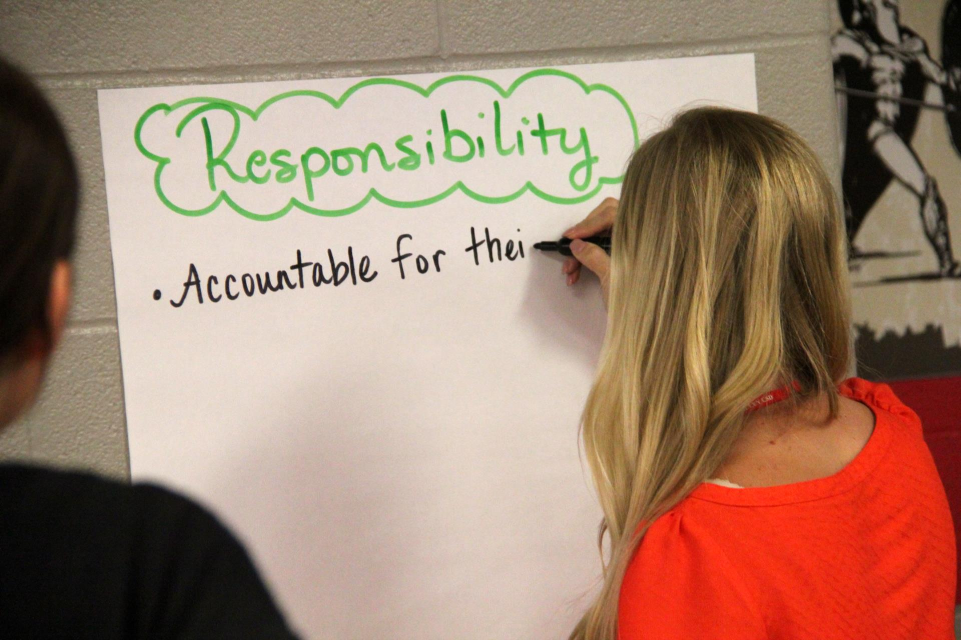 teacher writing about responsibility
