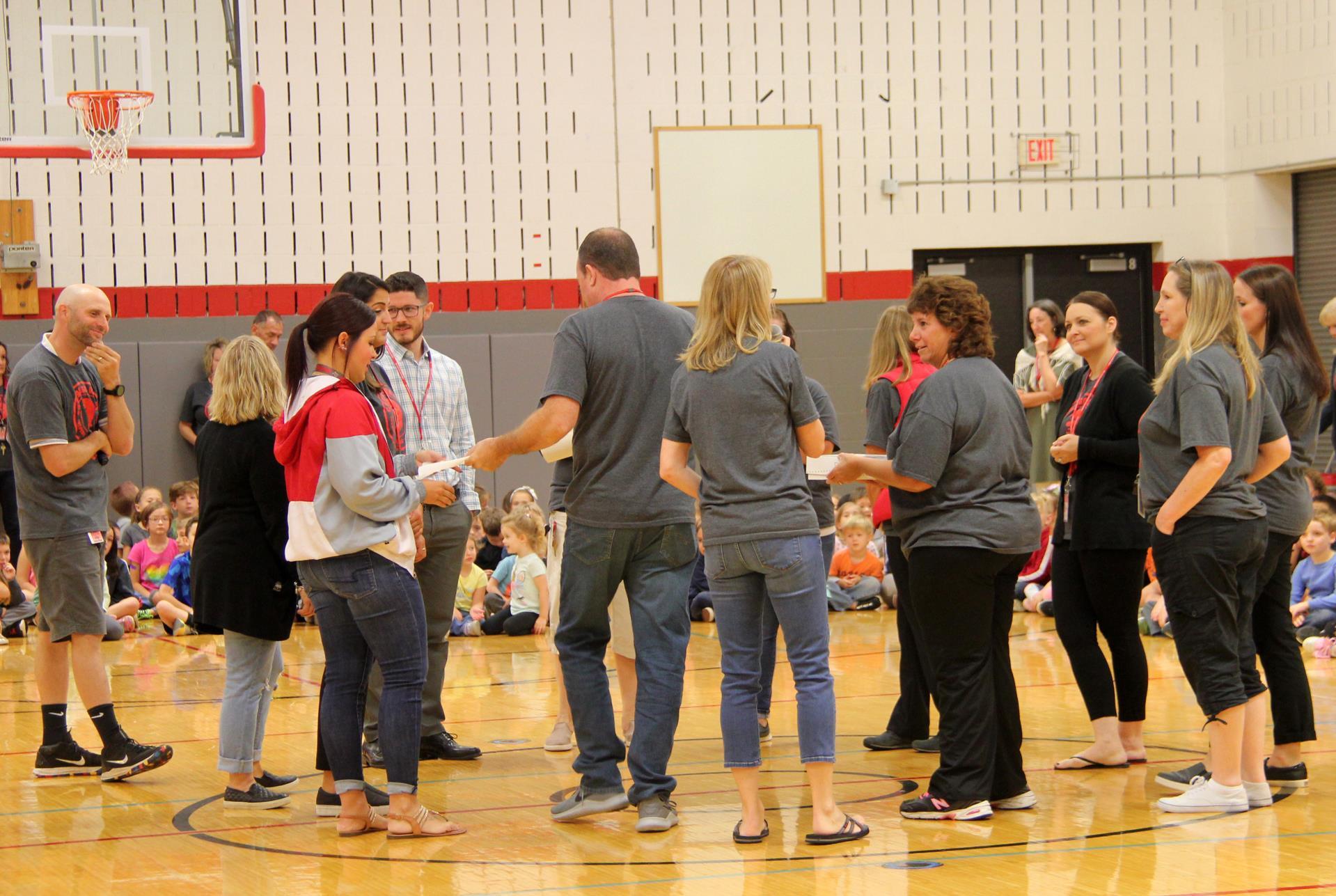 educators choosing donates at p 2 assembly