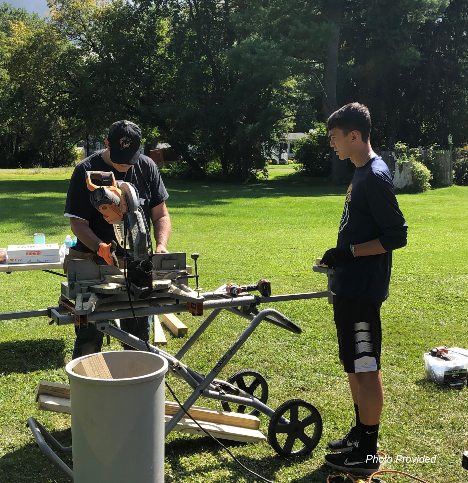 student and adult working with equipment