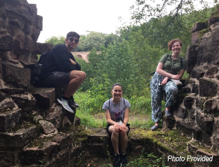 Students sitting on rocks