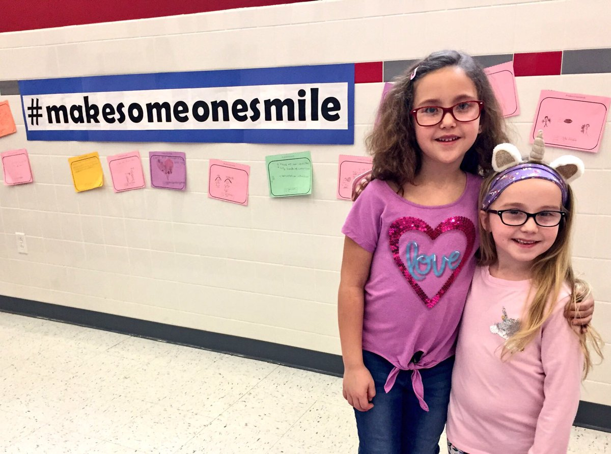 students next to make someone smile wall