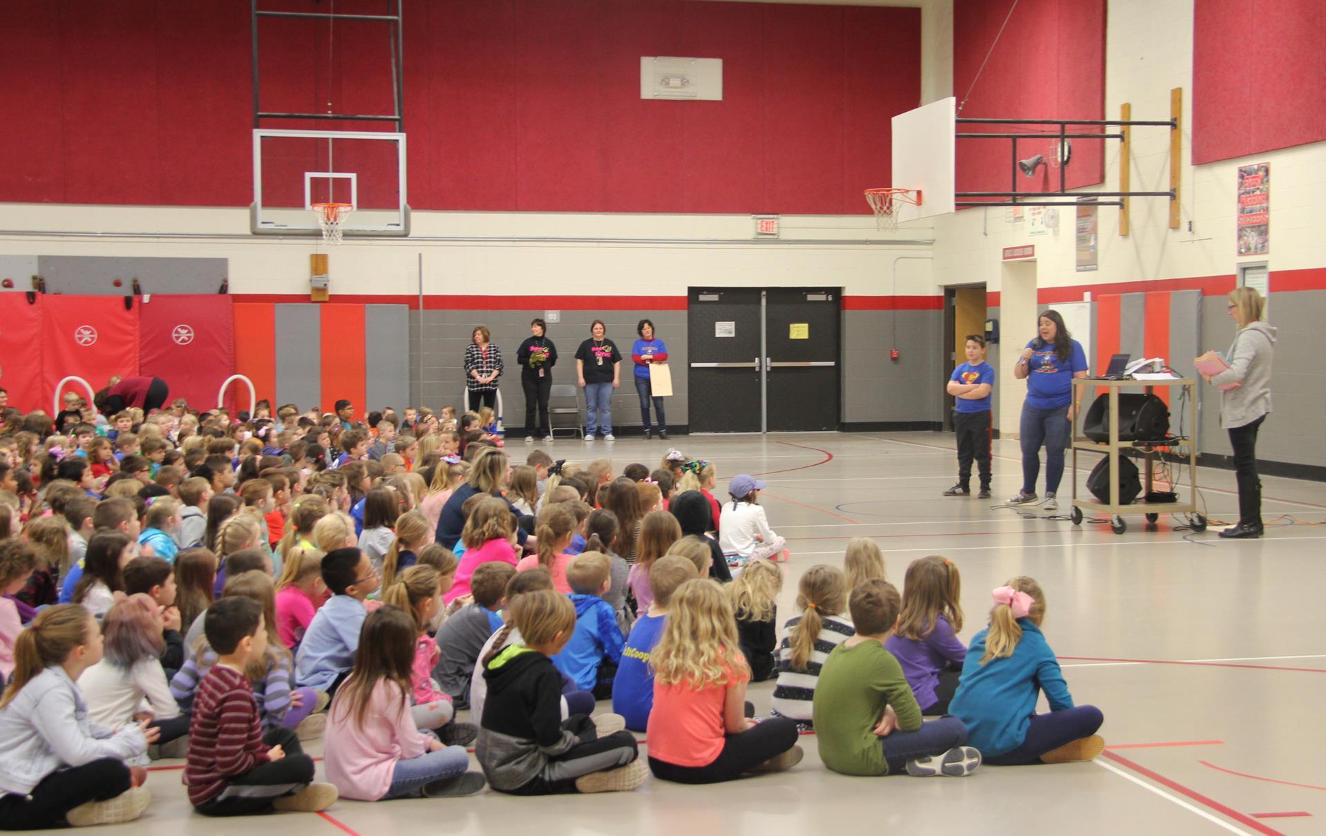 students listening to morning program presentation