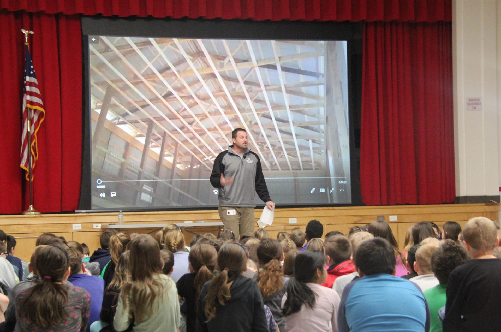 Animal Adventure owner speaking with students