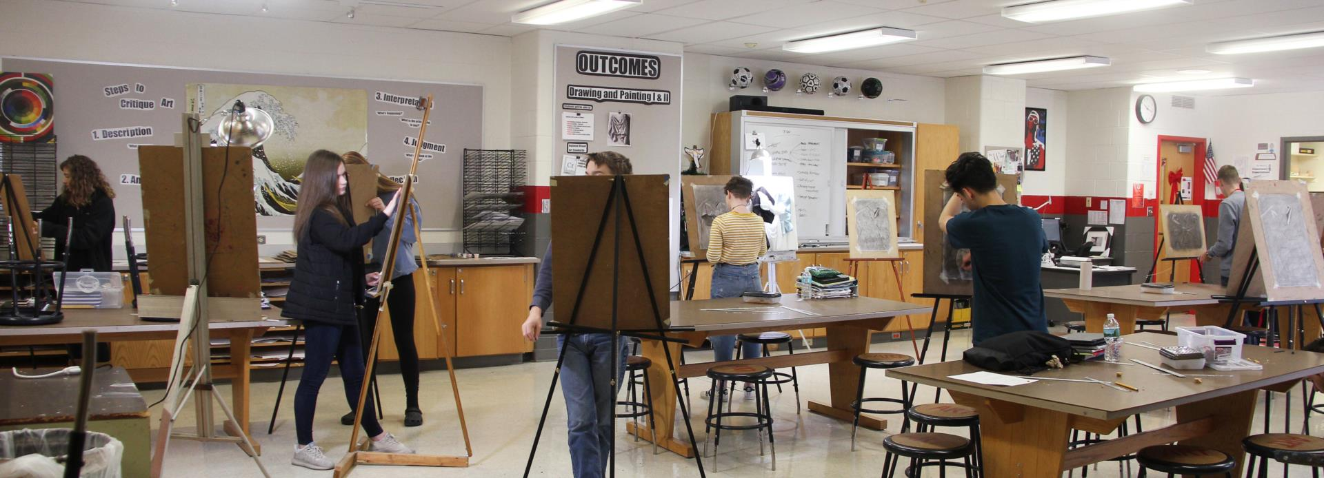 wide shot of class drawing