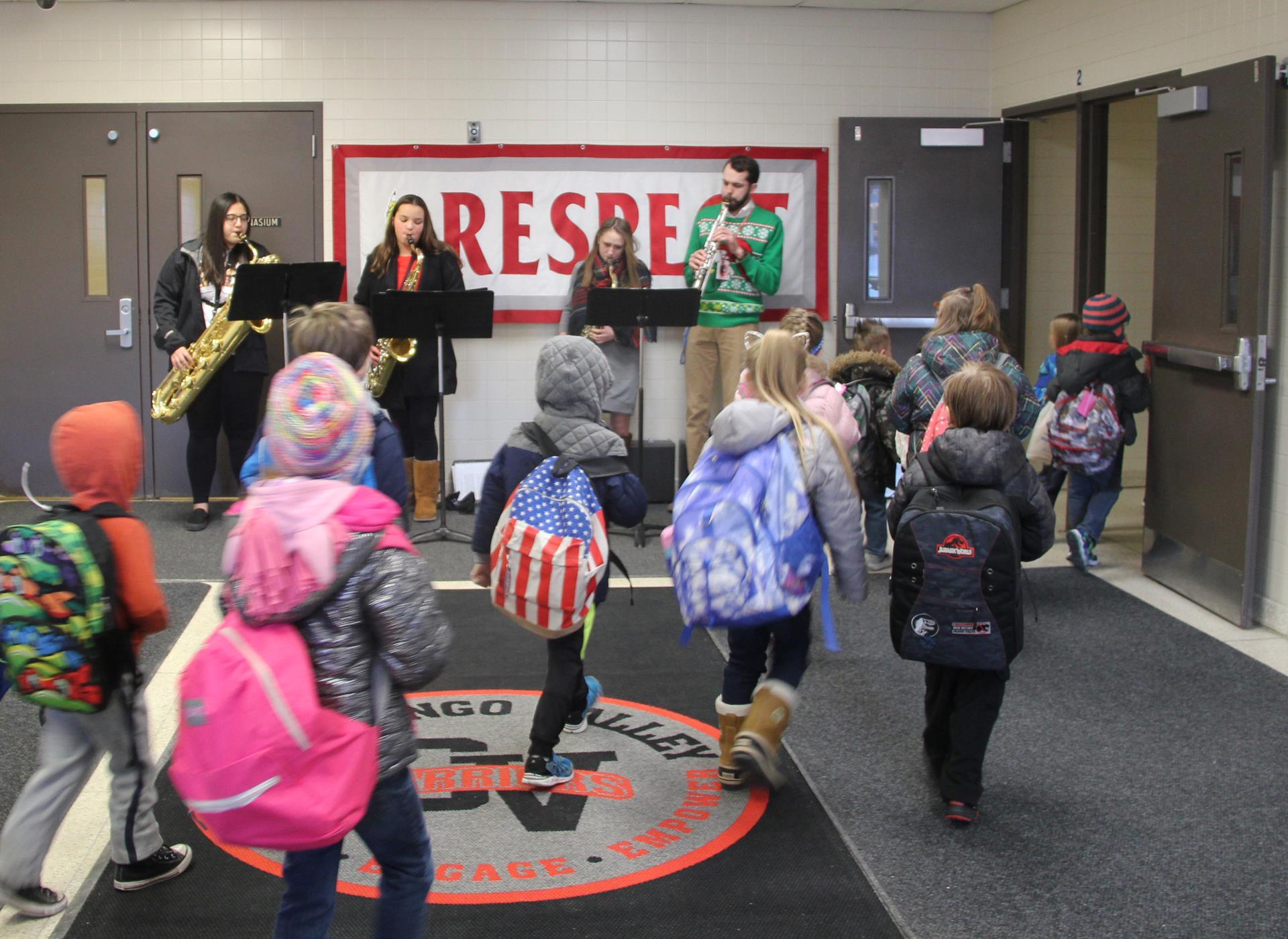 elementary students walking by saxophone ensemble