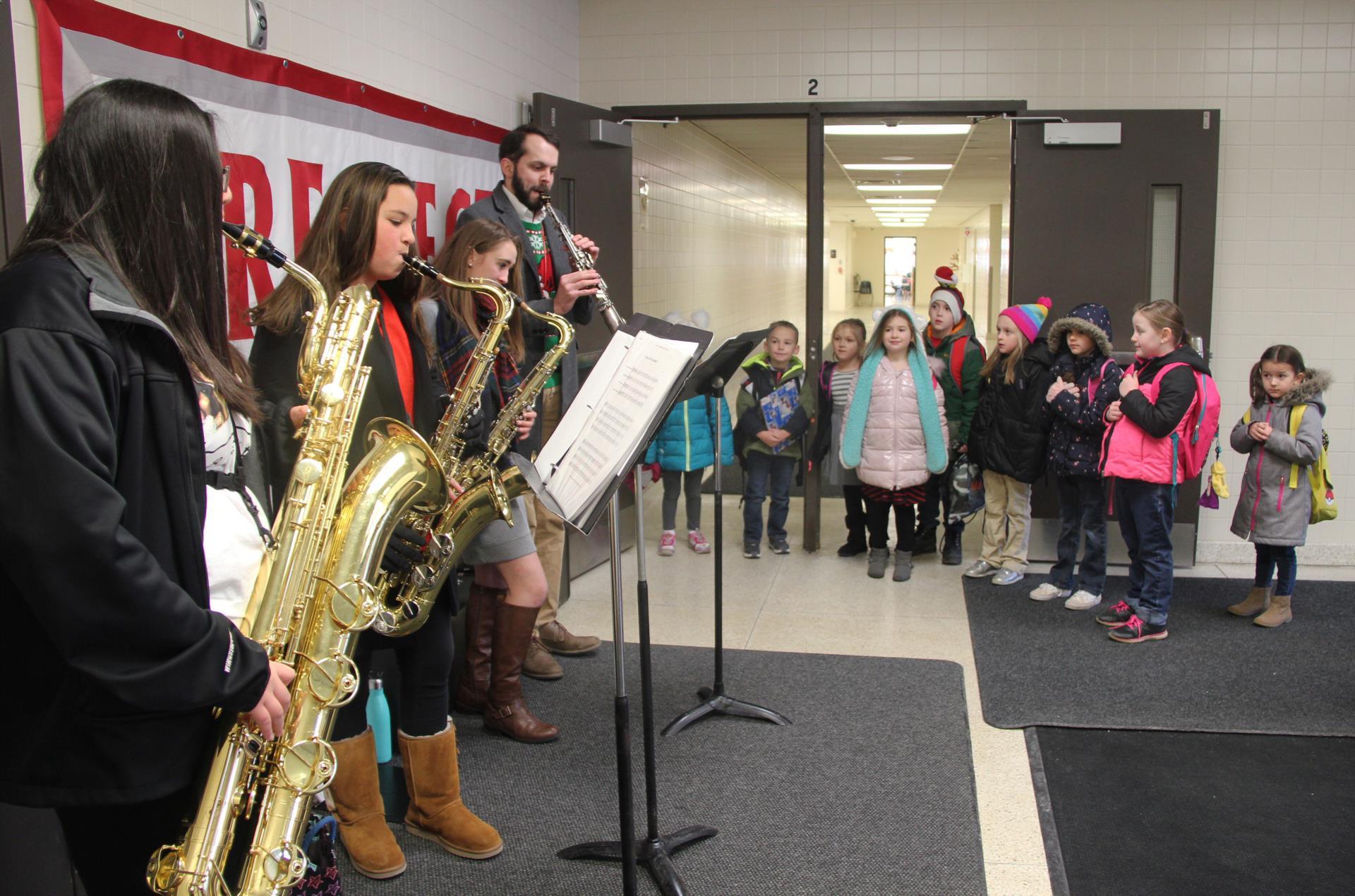 elementary students watching saxophone ensemble