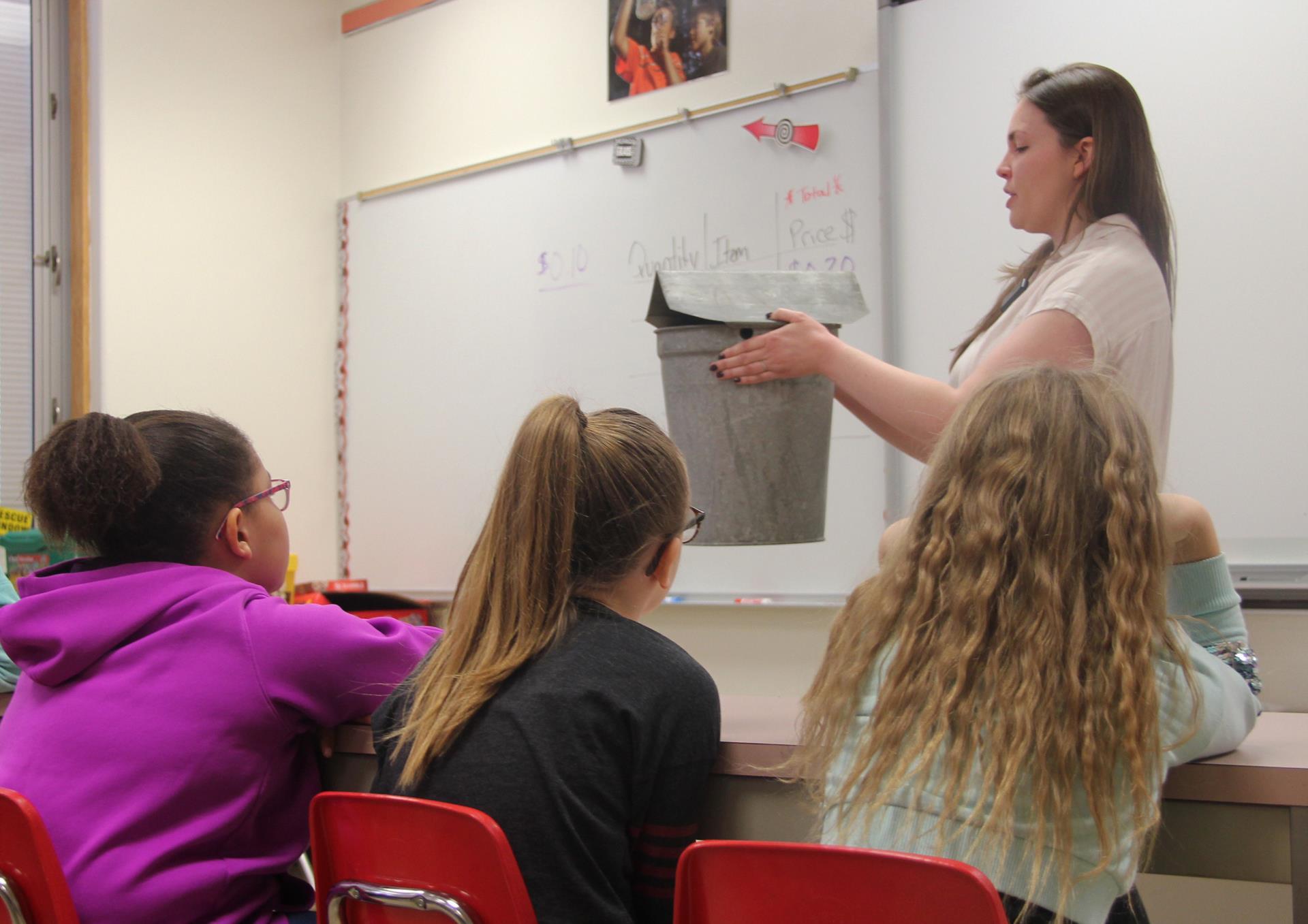 representative showing students bucket