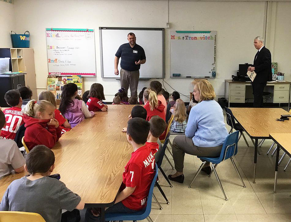 Cornell Cooperative Extension Representative speaking with class