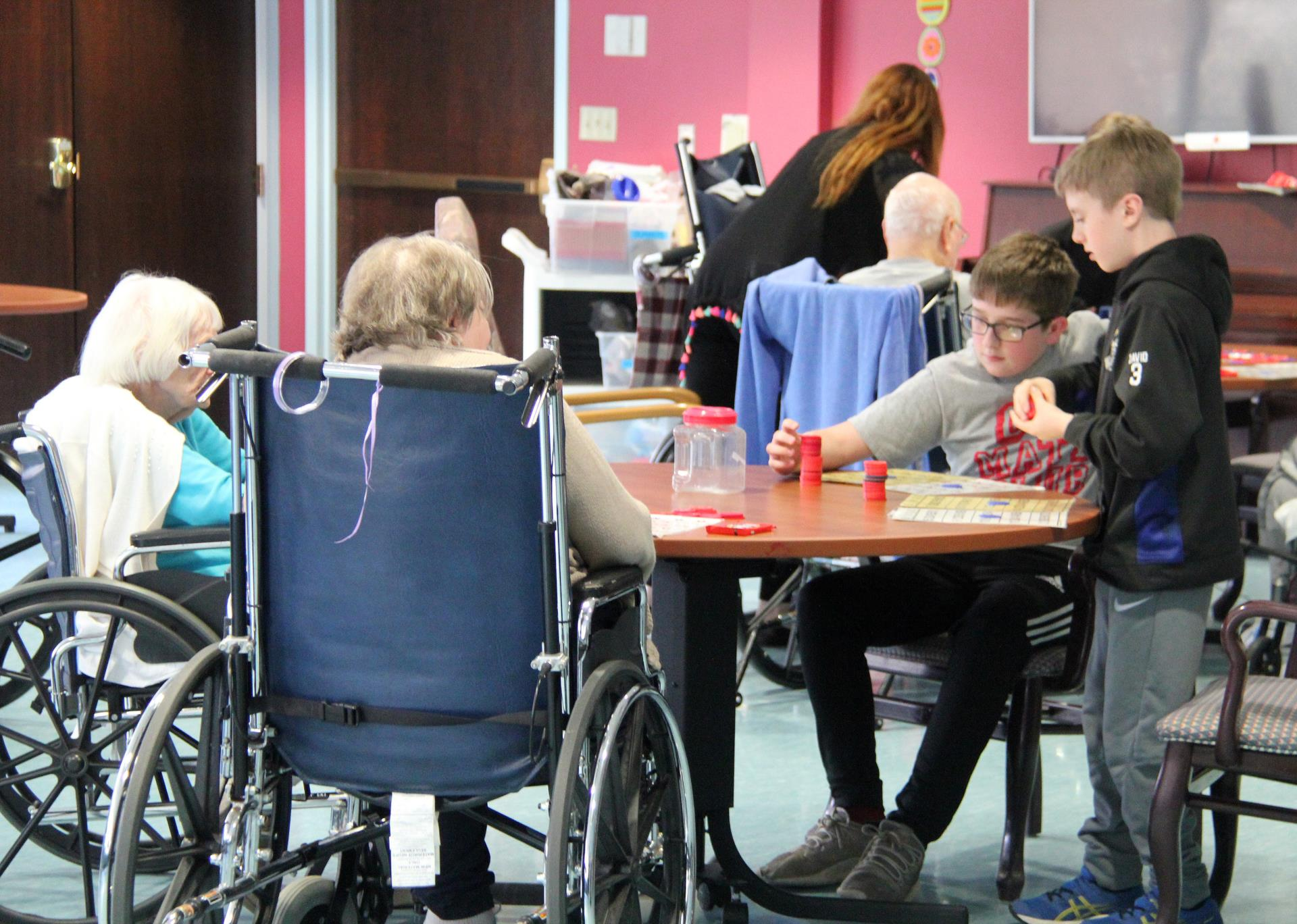 students playing bingo with elizabeth church manor residents