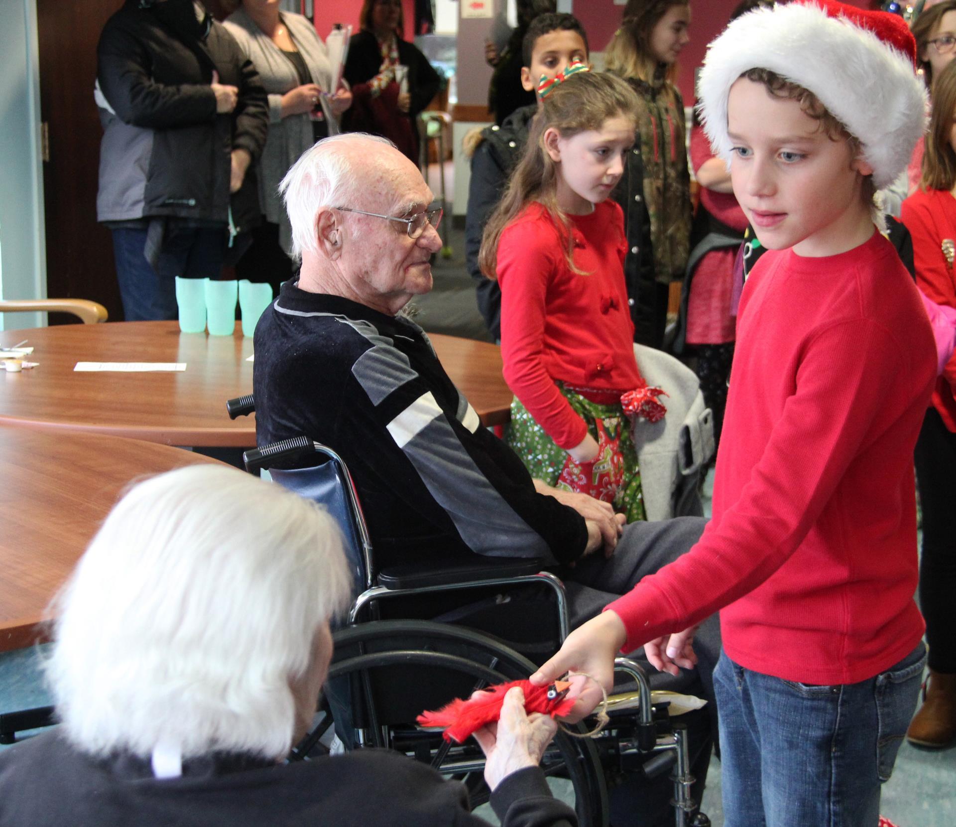 student handing resident ornament