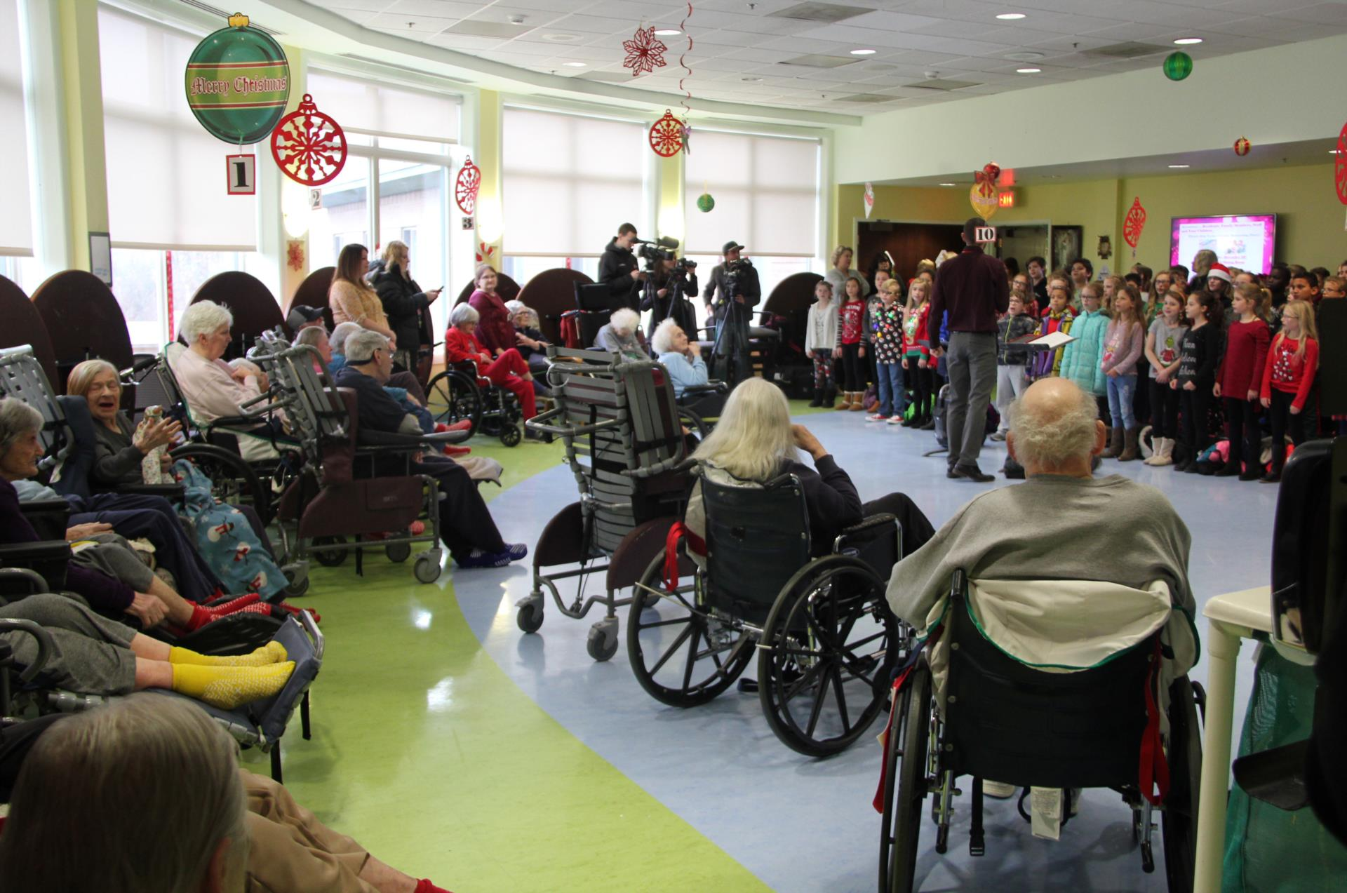 students singing for elizabeth church manor residents