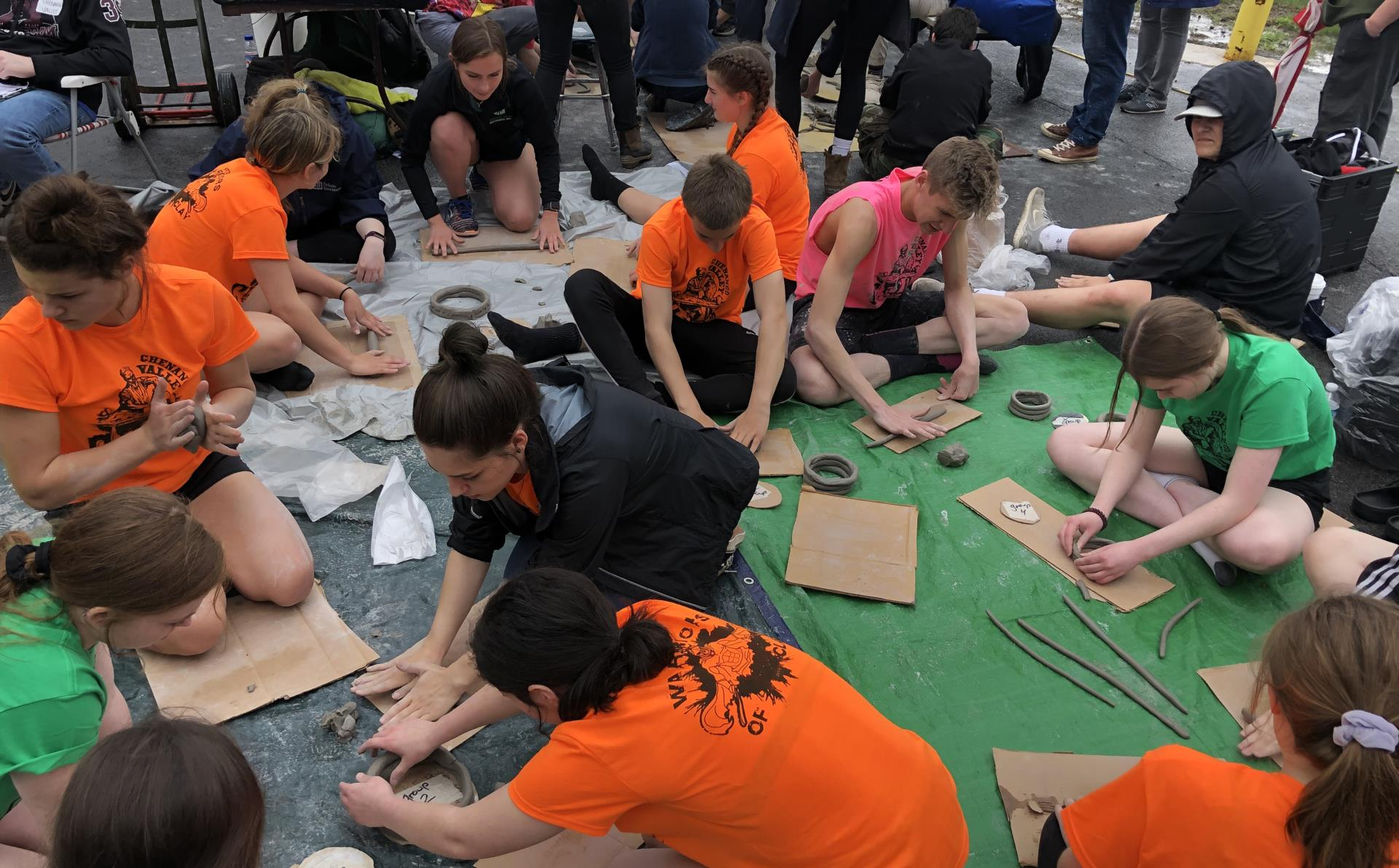 students taking part in feats of clay competition event