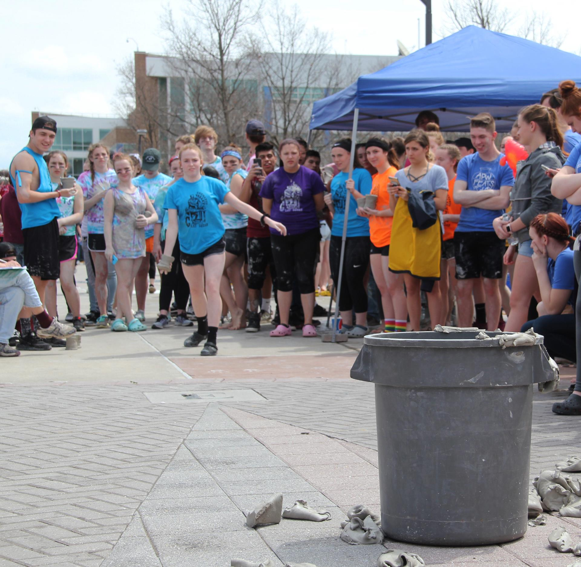 student throwing mug in pot put event