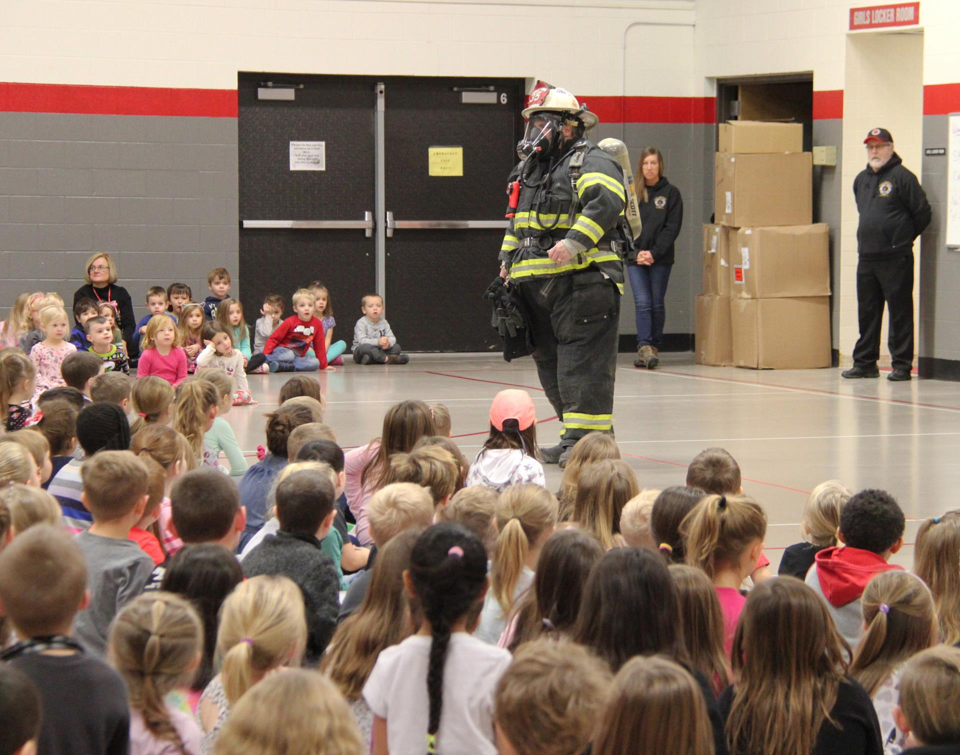 students watching fire safety presentation