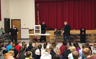 wide shot of auditorium at fire safety assembly