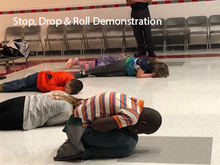 more people doing stop drop and roll demonstration