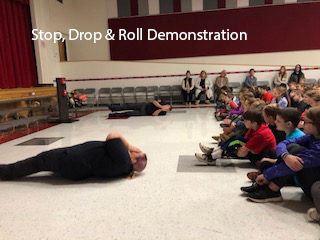 people doing stop drop and roll demonstration