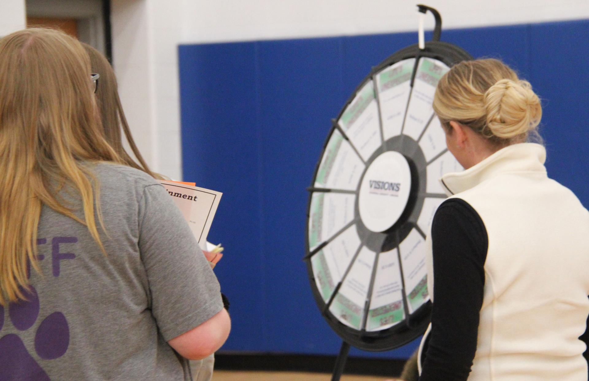 students spinning wheel at life is a reality event