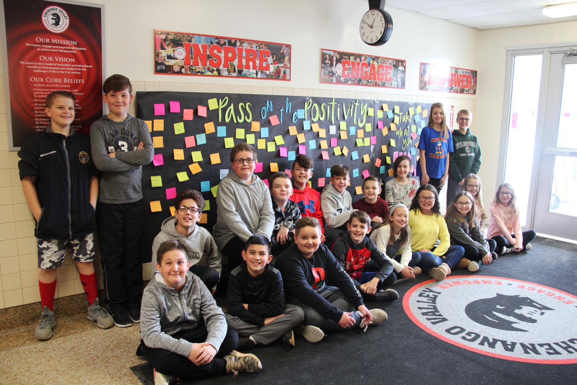 fifth grade student council members next to pass on the positivity wall