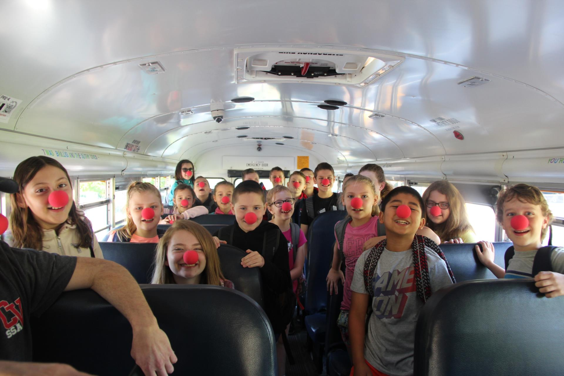 students wearing red noses on bus