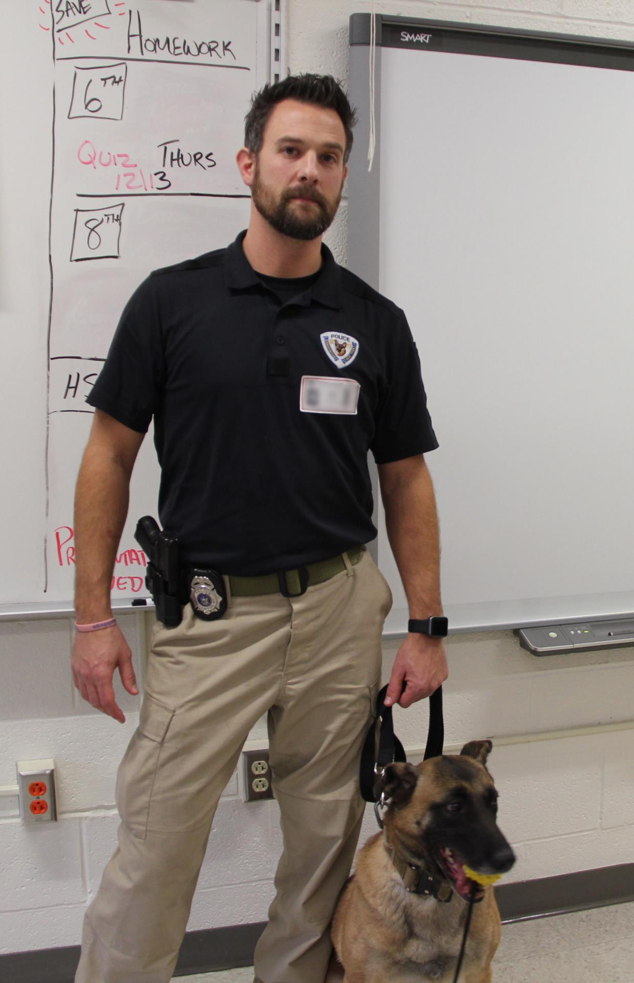 officer and k 9 standing