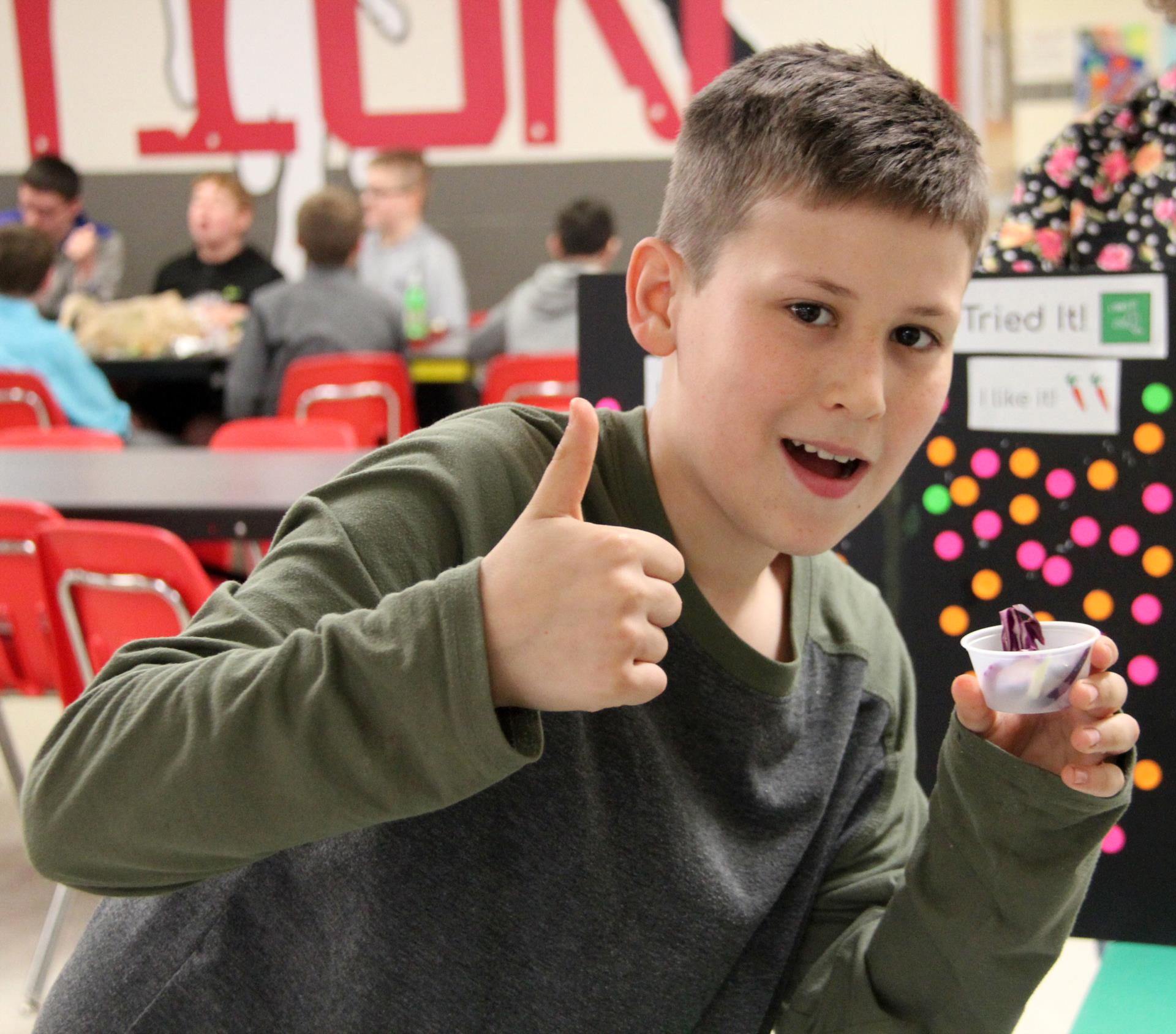 student giving thumbs up for cabbage salad