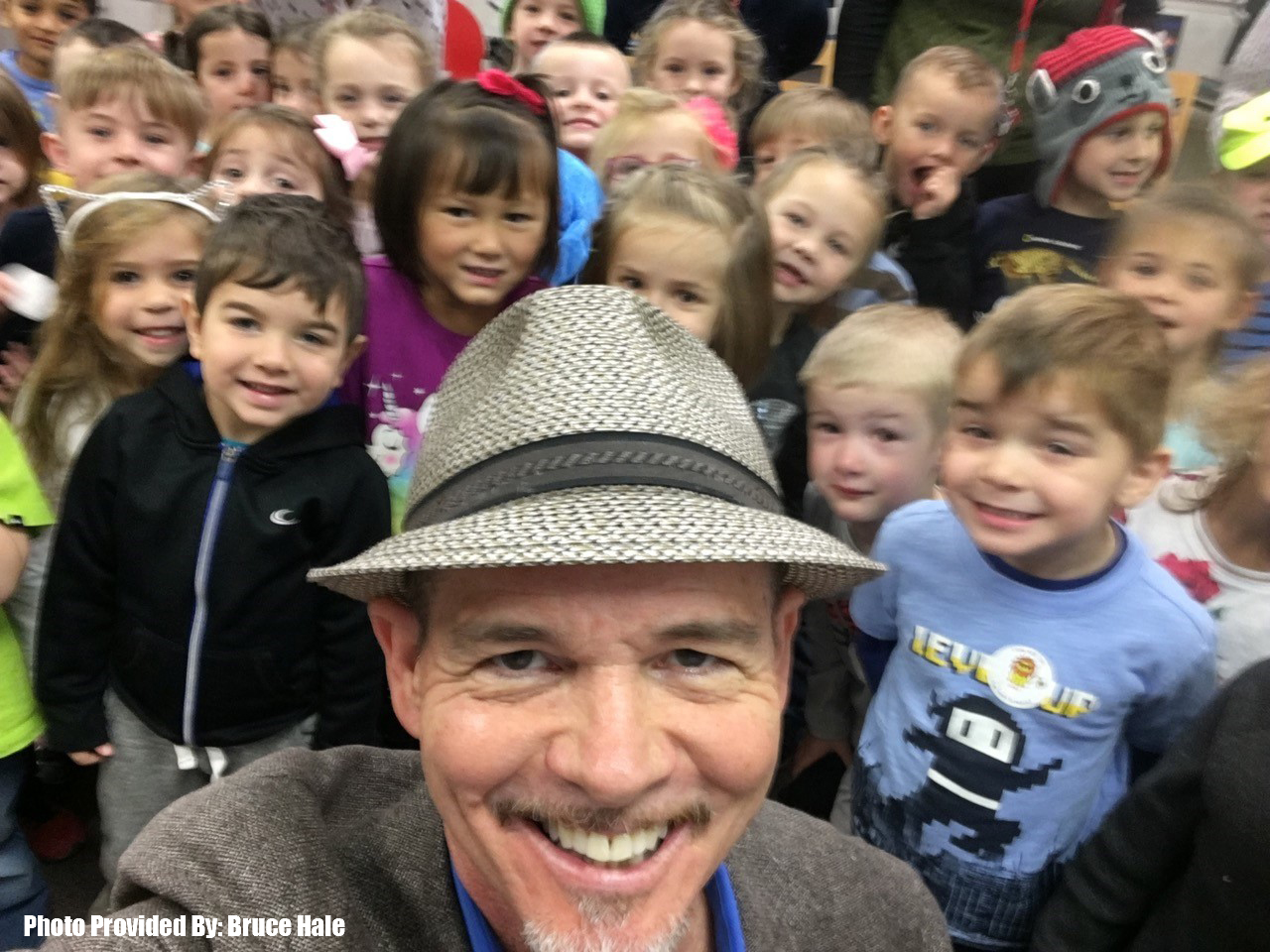 bruce hale taking selfie with students