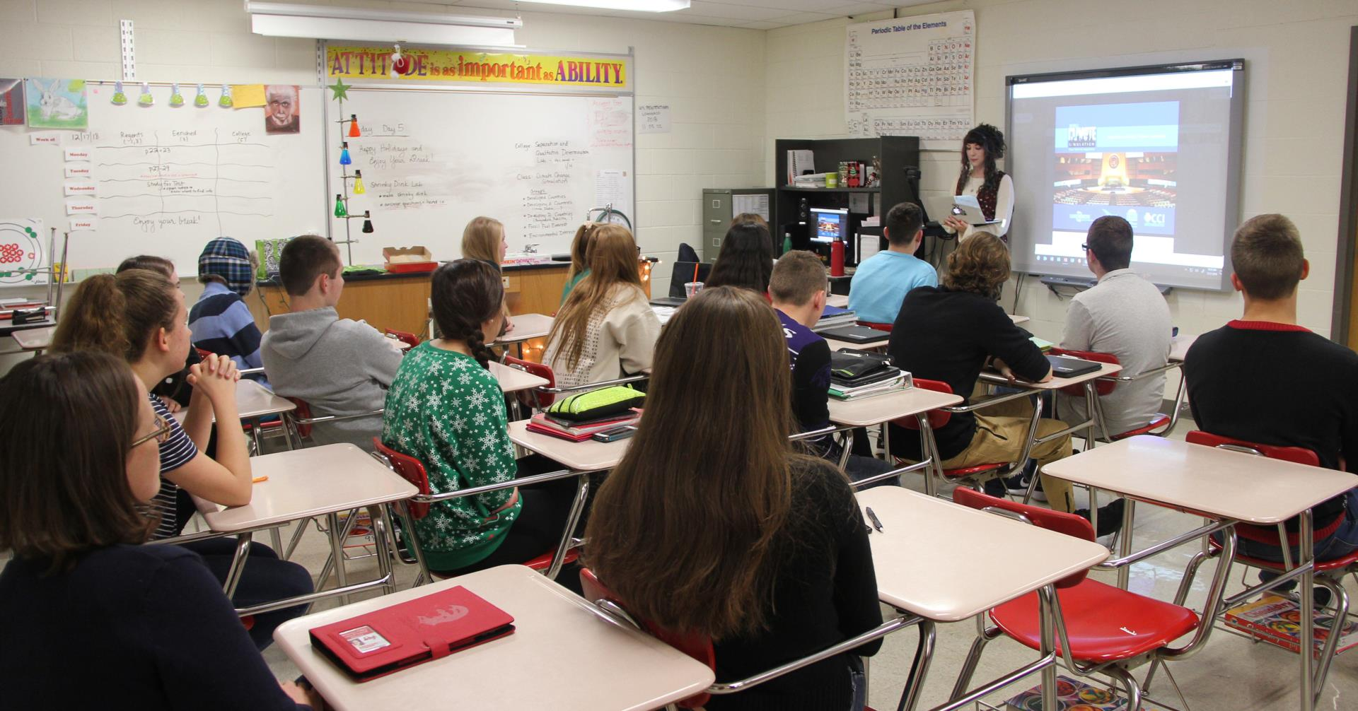 alum talking to students in classroom