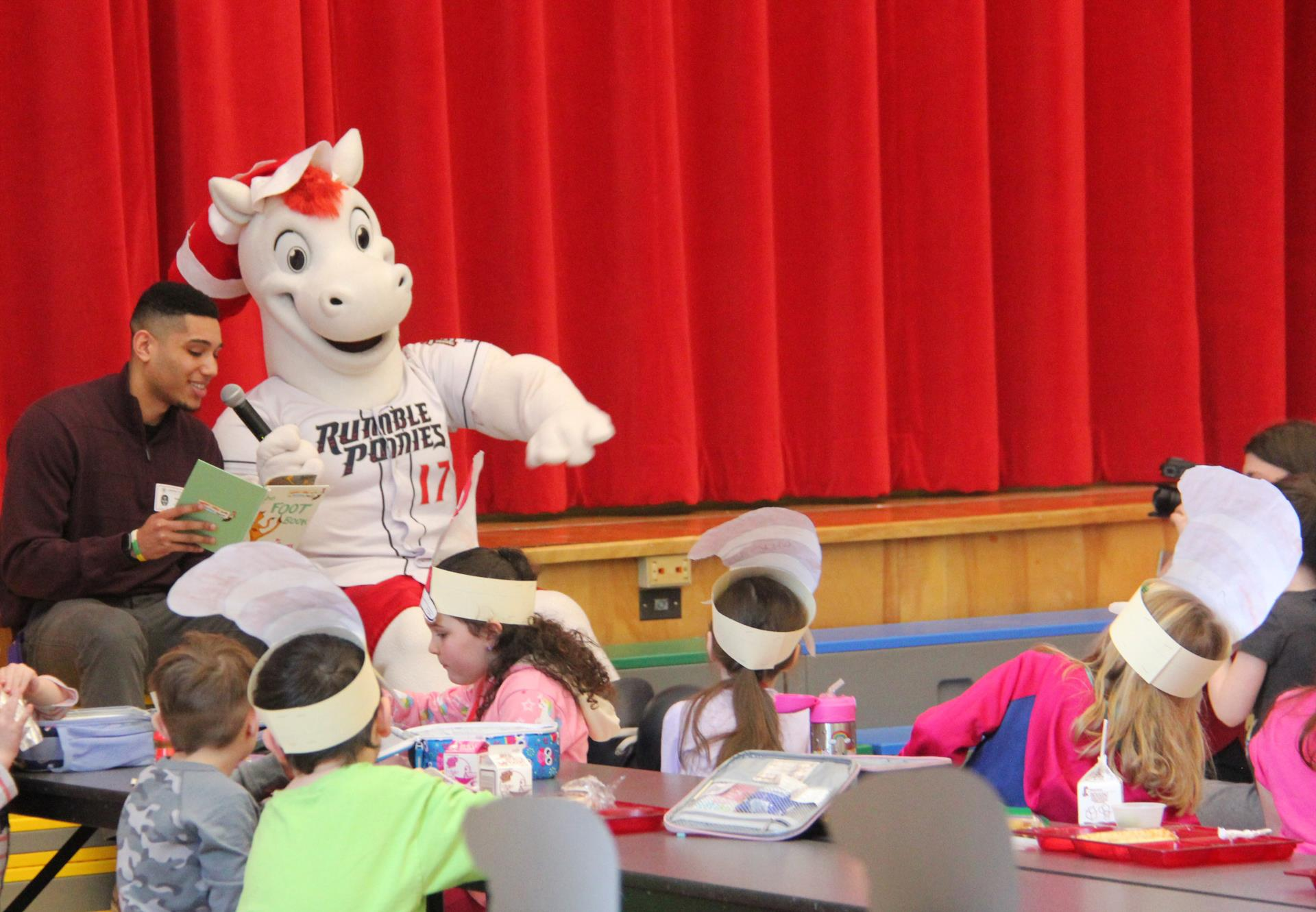 rowdy and rumble ponies representative reading to students