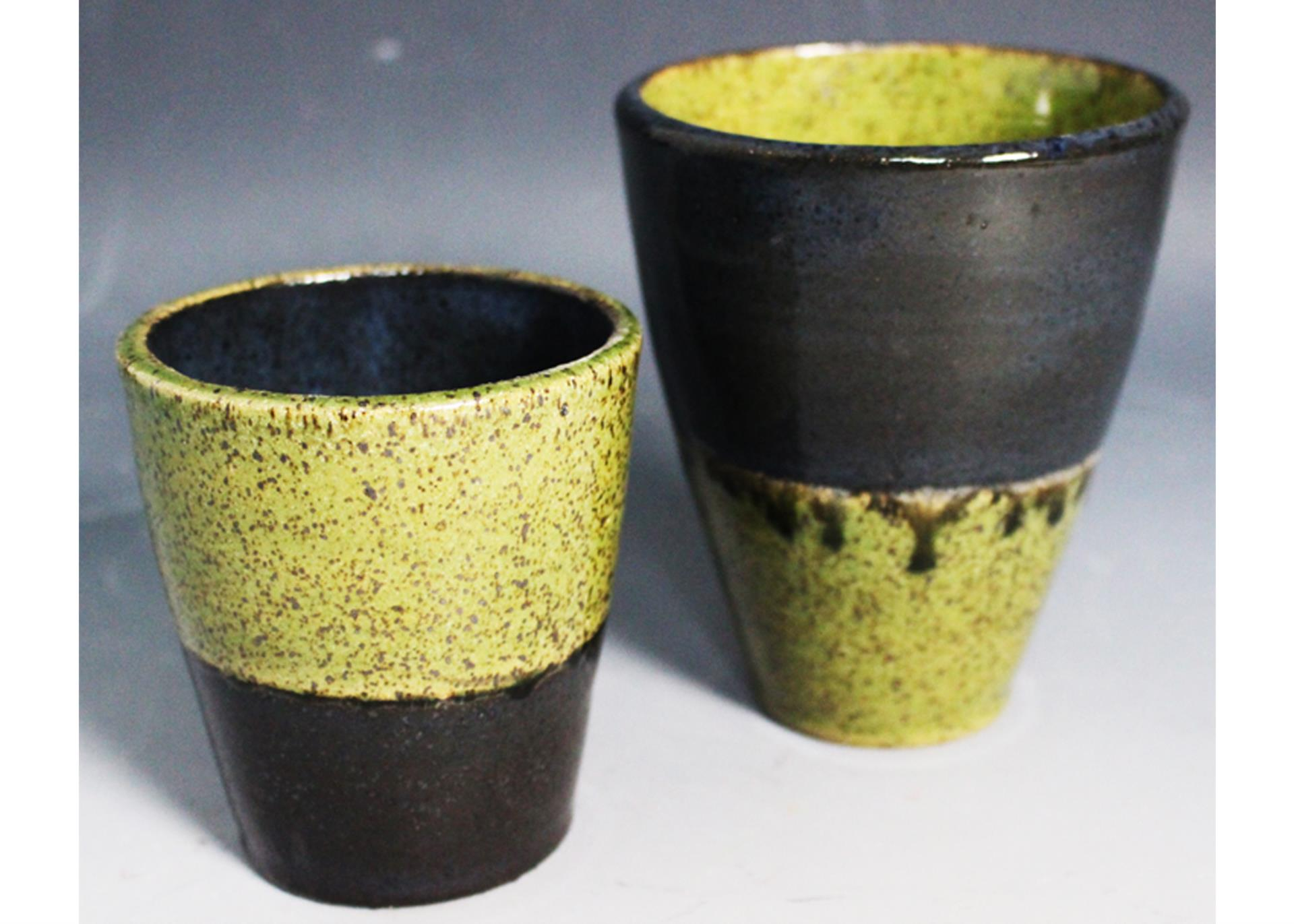 two ceramic tumbler cups
