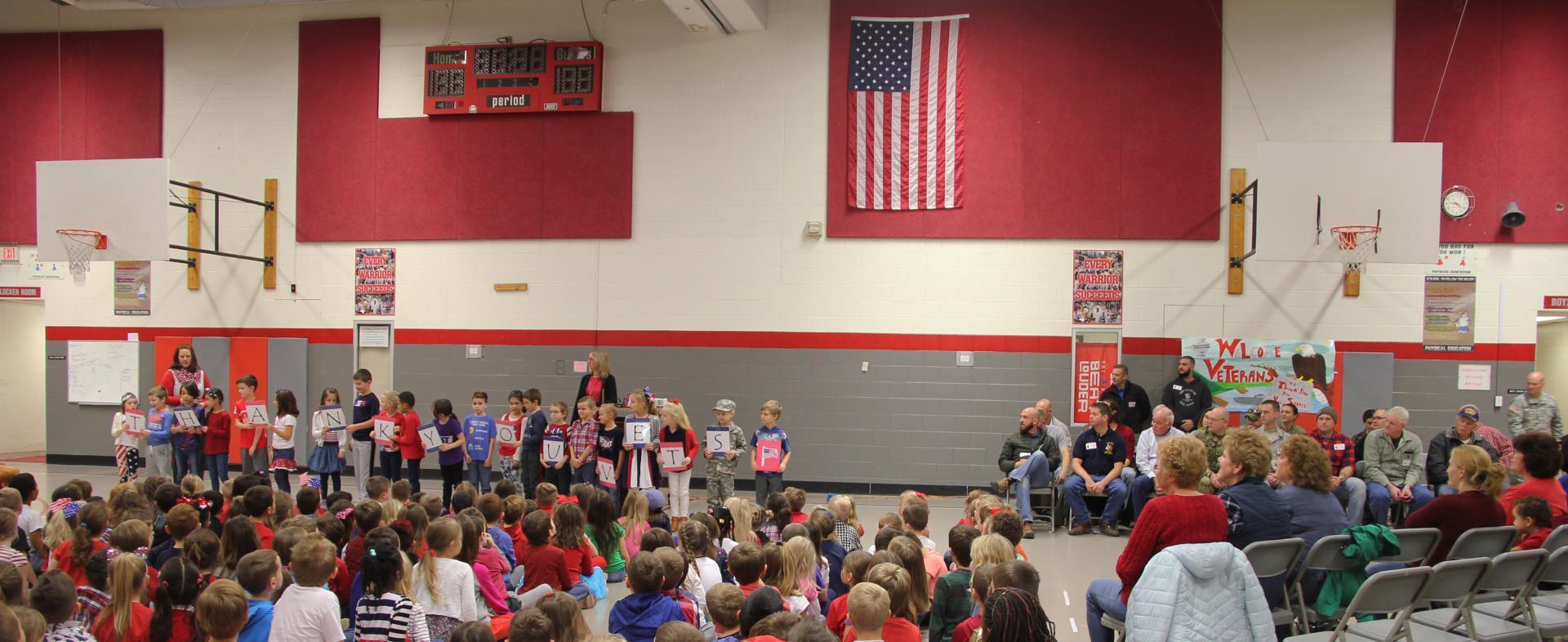 students reading patriotic poem to veterans
