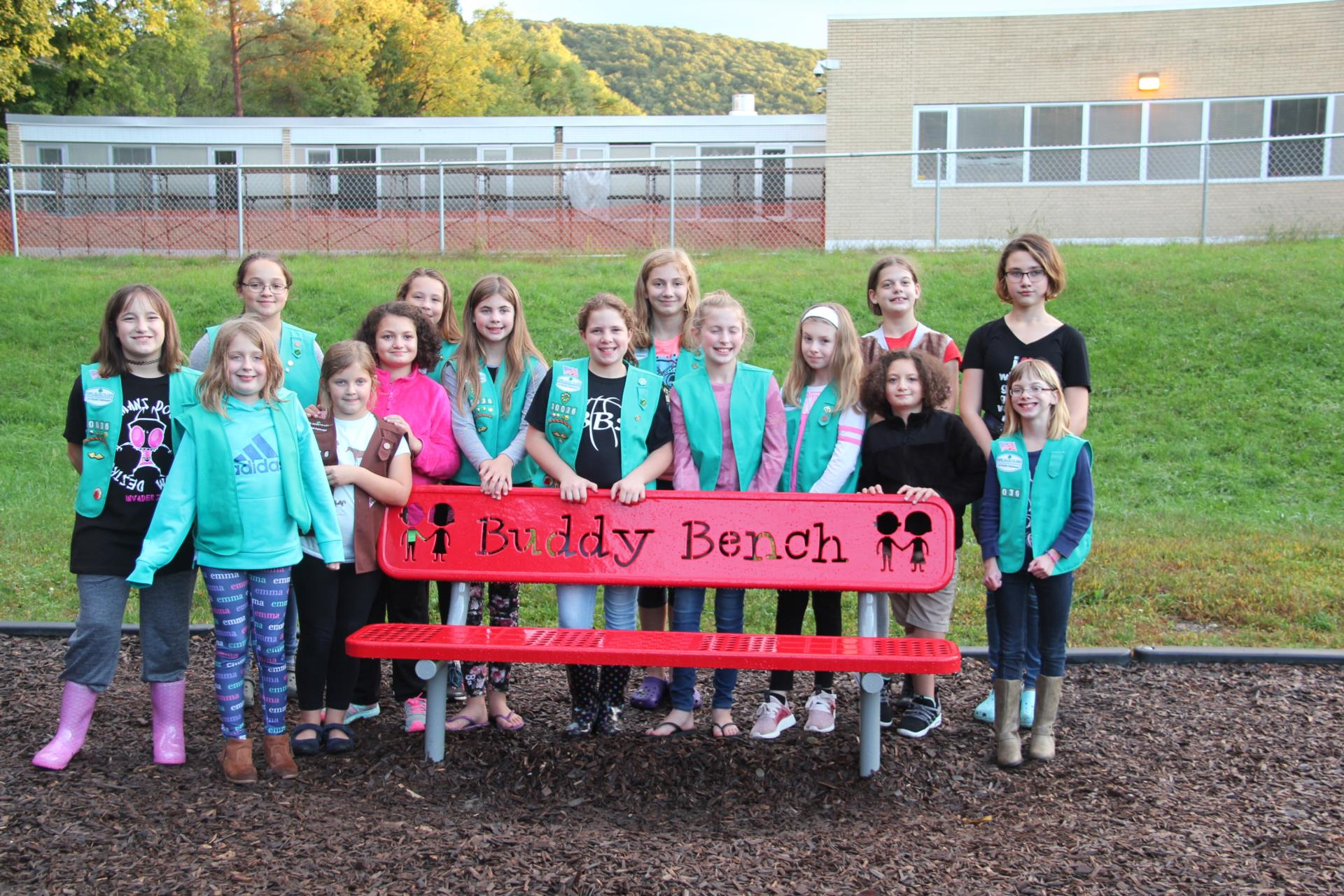 another photo of girl scout troop and buddy bench
