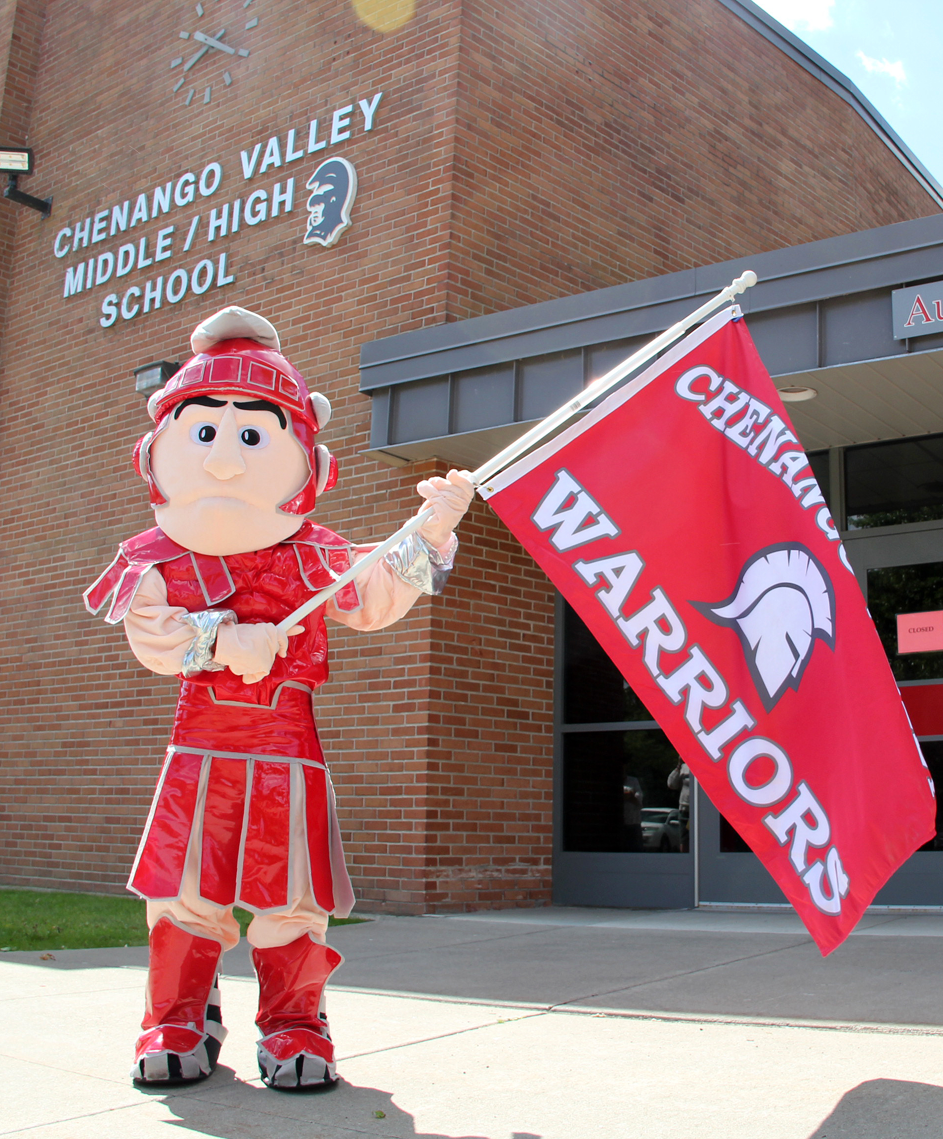 Warrior mascot with flag