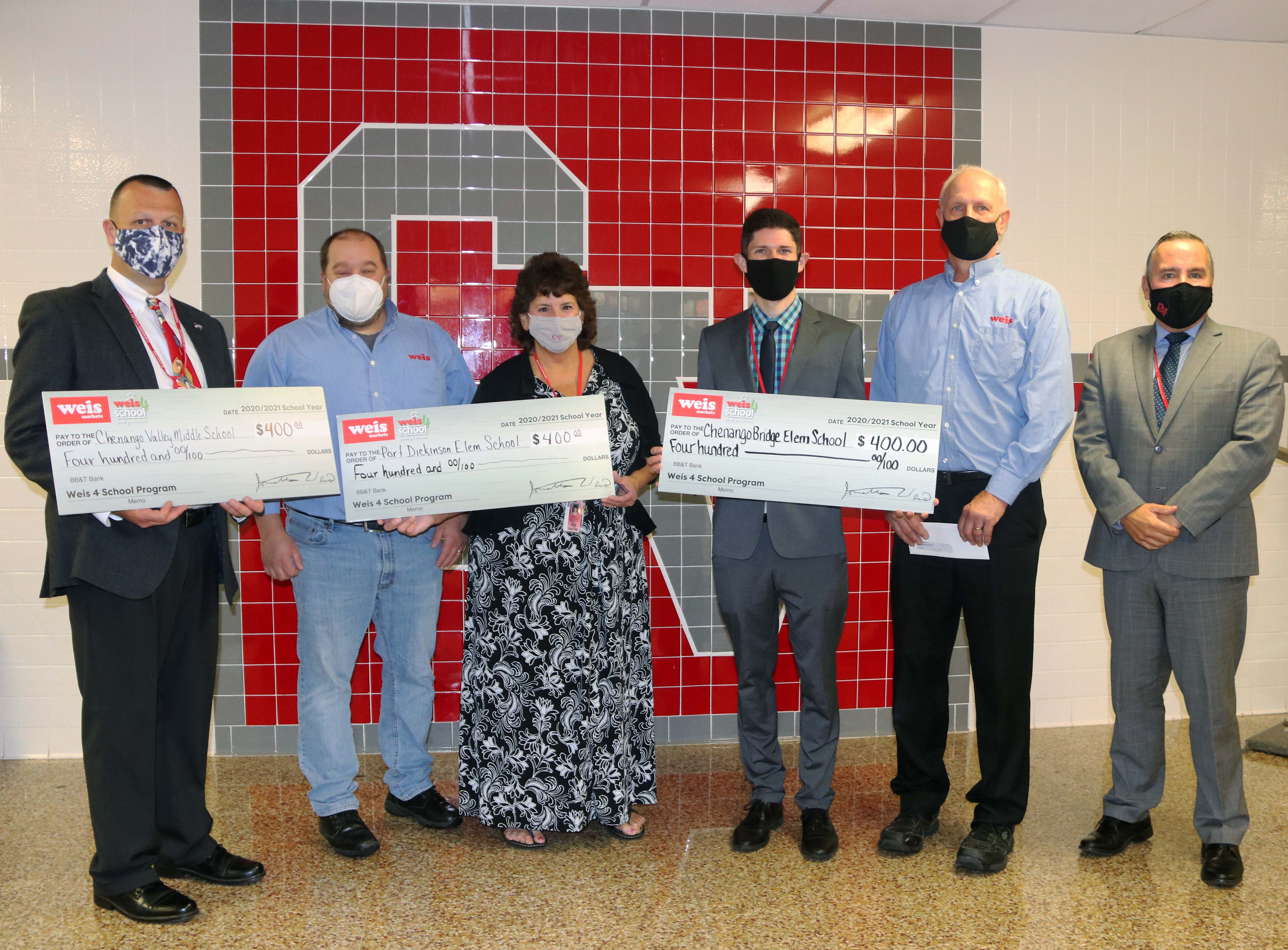 principals being presented with weis donations