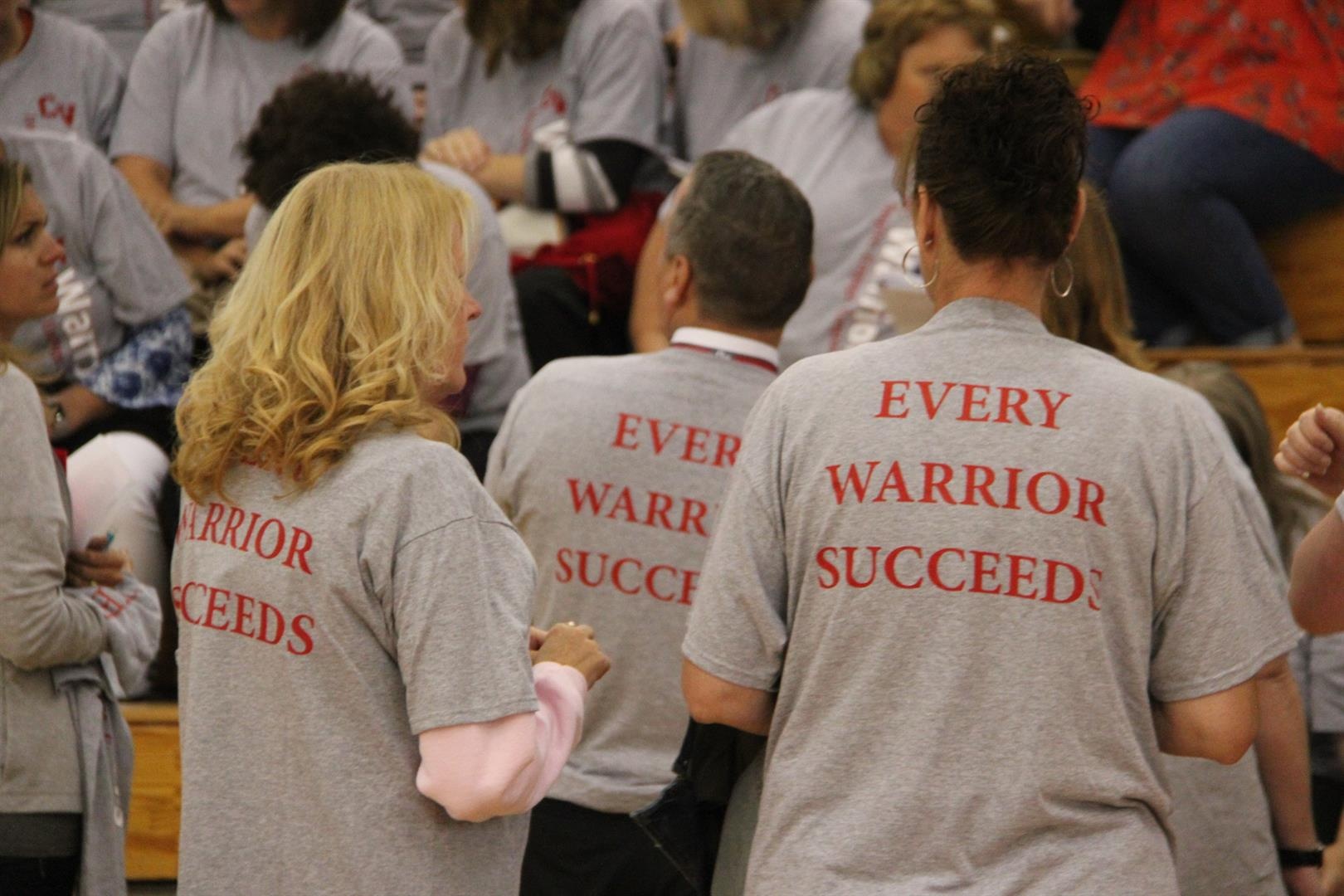 back of staff tees that reads every warrior succeeds