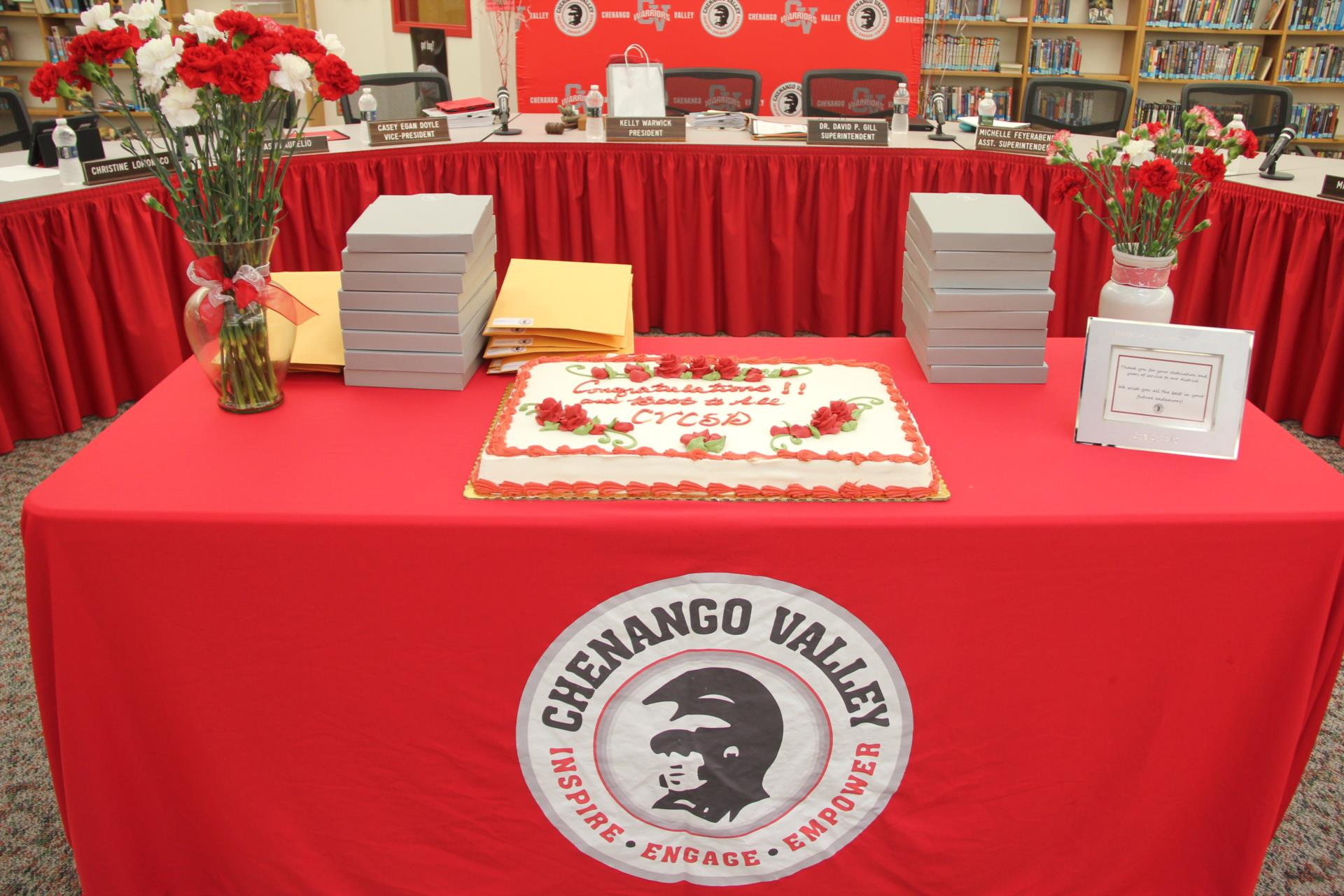 cake and recognition plaques