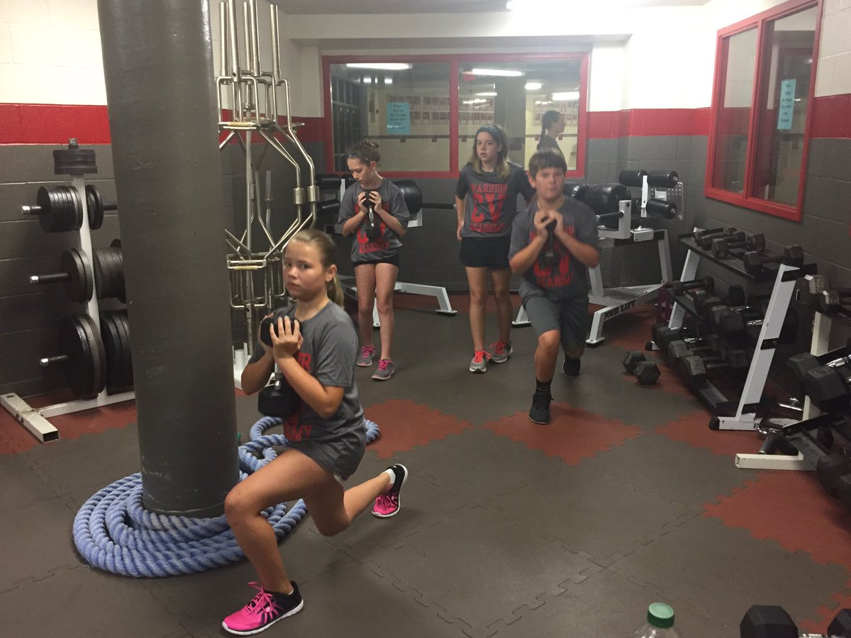 chenango valley warrior academy students work with weights in the weight room