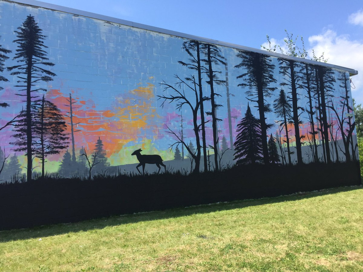 closer look at depot wall painting update shows trees in black paint and deer