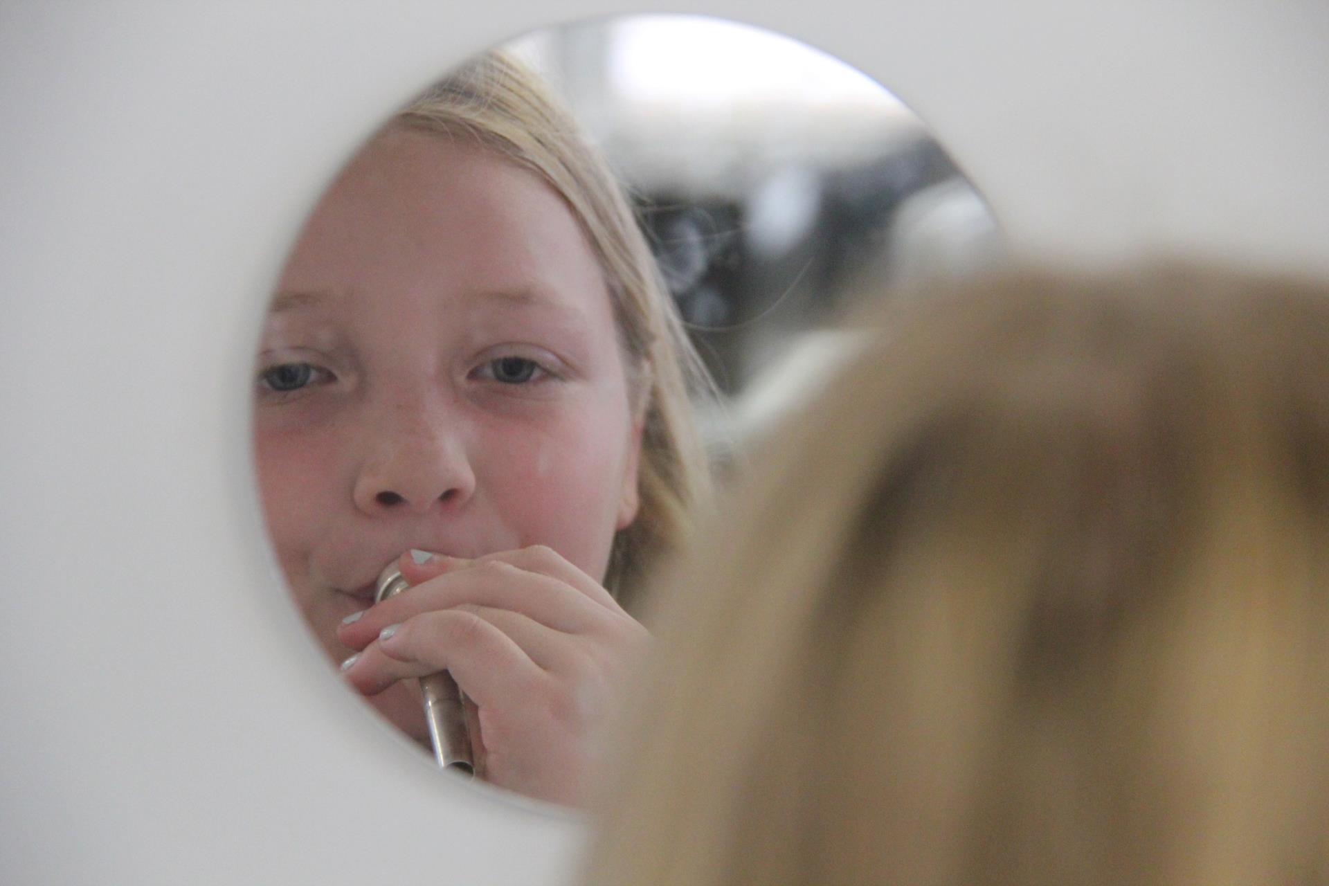 close up of student in mirror
