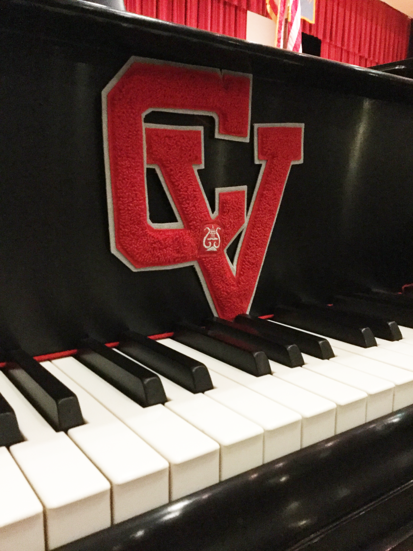 c v logo on piano