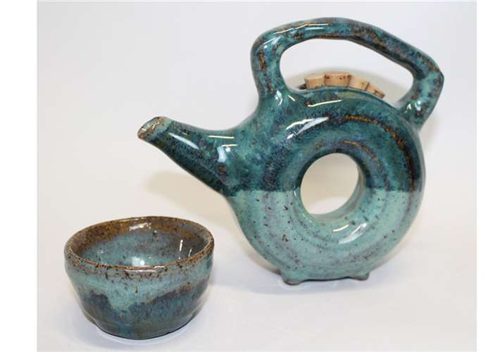 "Ceramic Piece titled ""Circle Tea Pot with Cup"""
