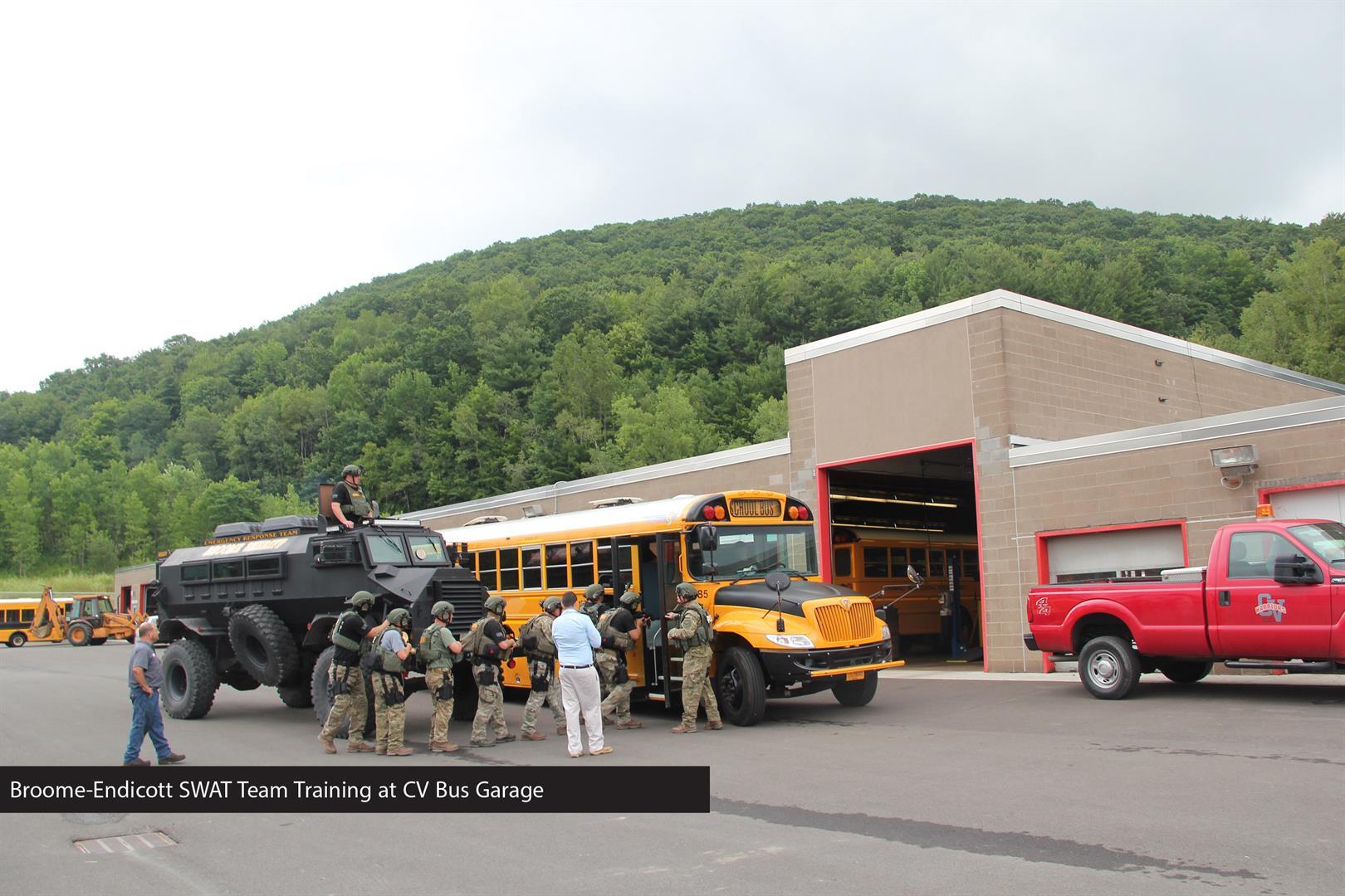far shot of members of broome endicott swat team training at c v bus garage