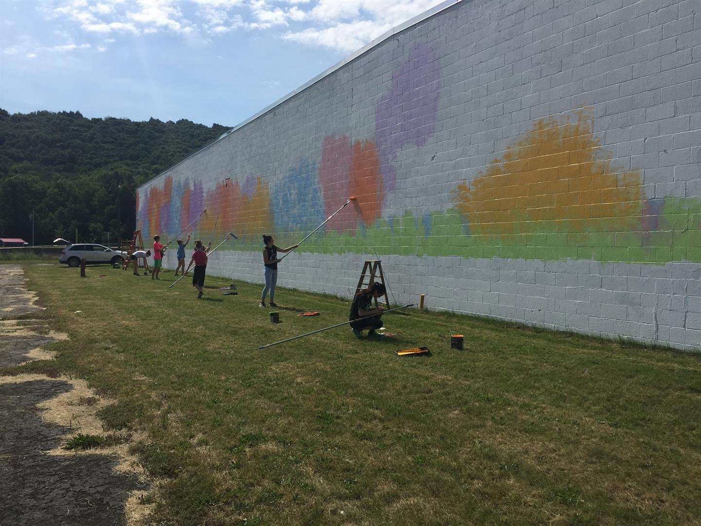 far shot of students painting