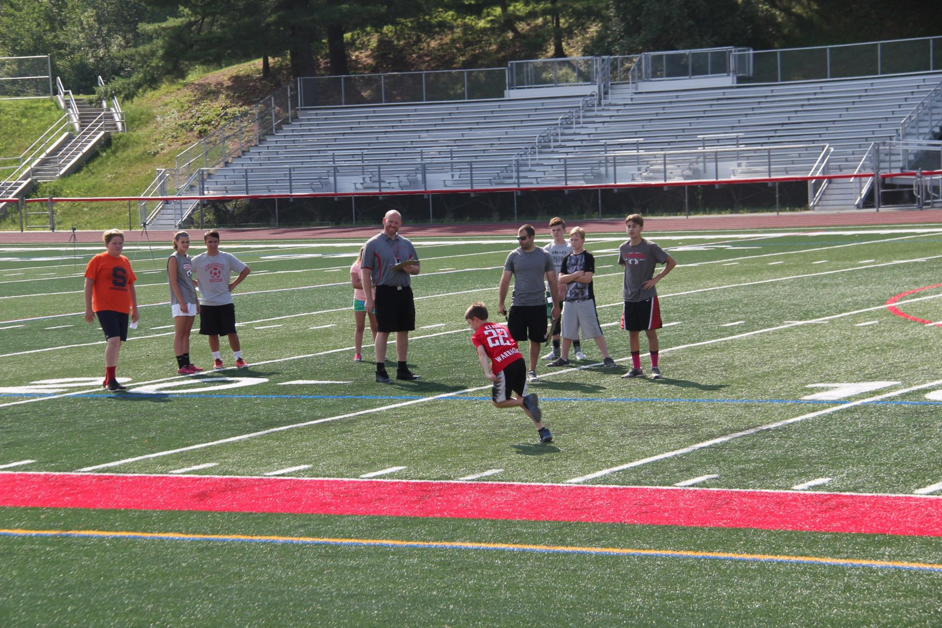 far shot of student running at warrior academy 2017