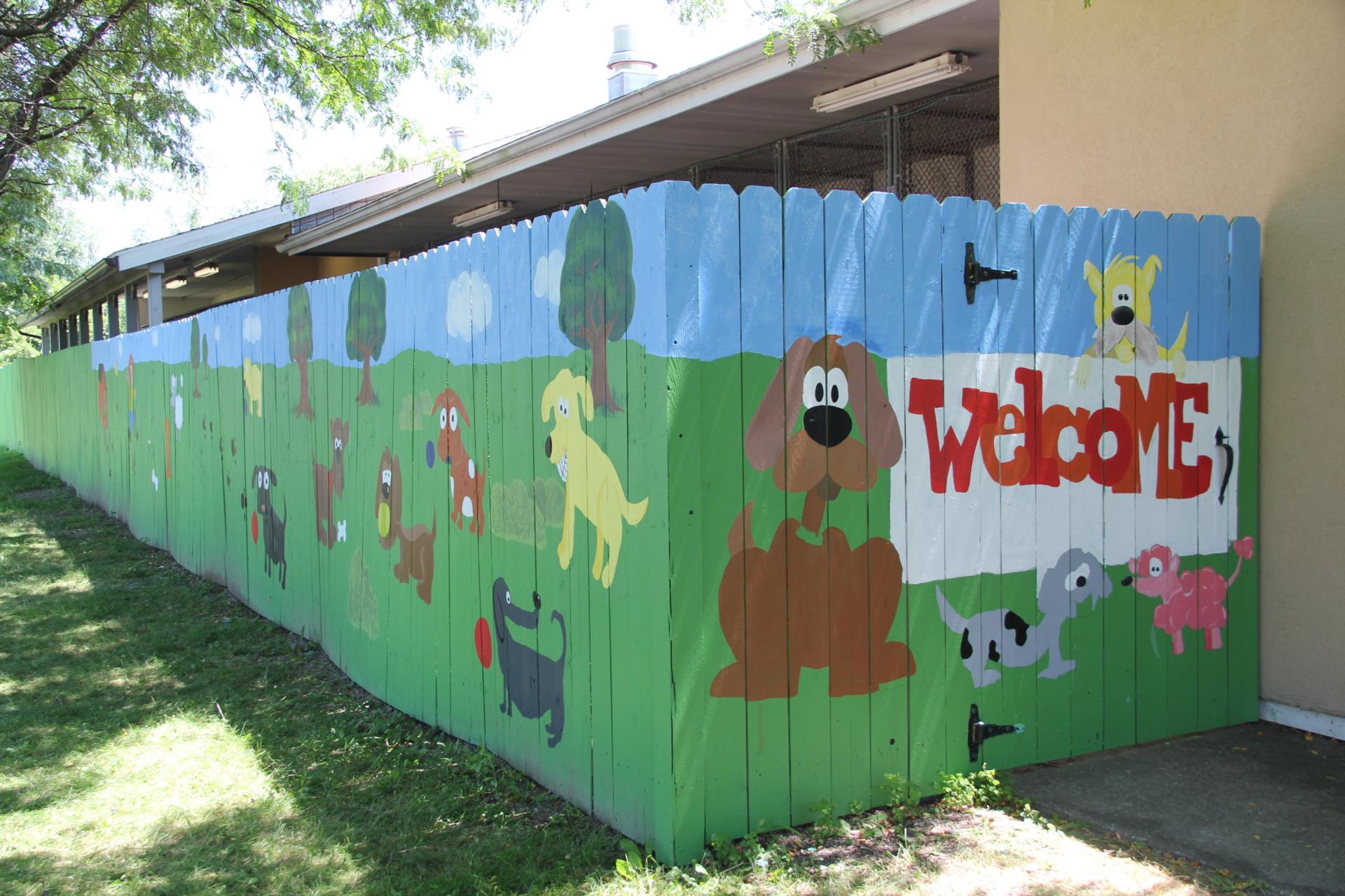 fence mural in progress