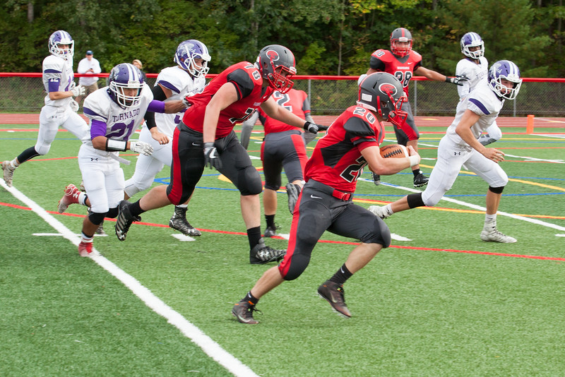 football players running chenango valley has the ball