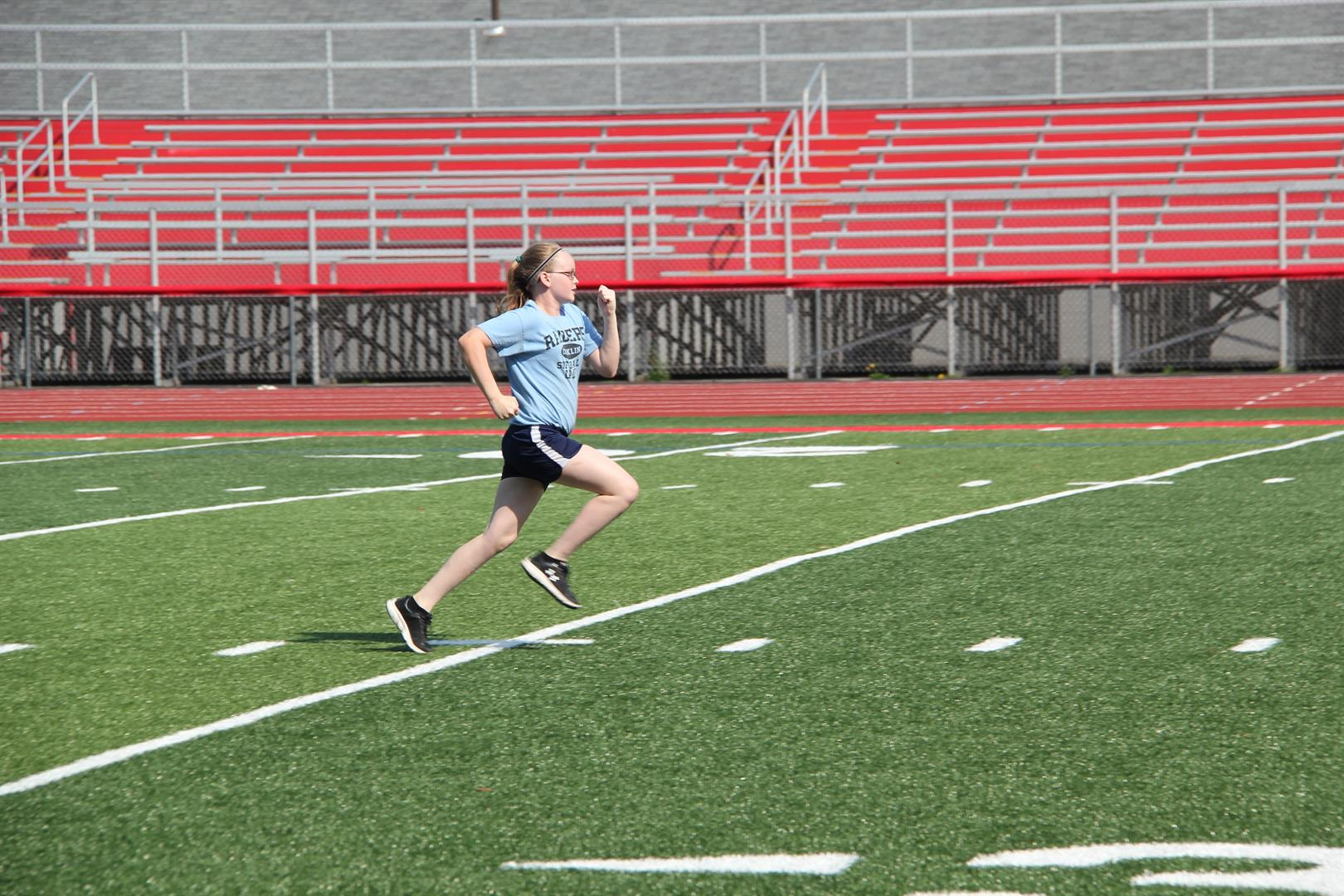 girl running at warrior academy 2017