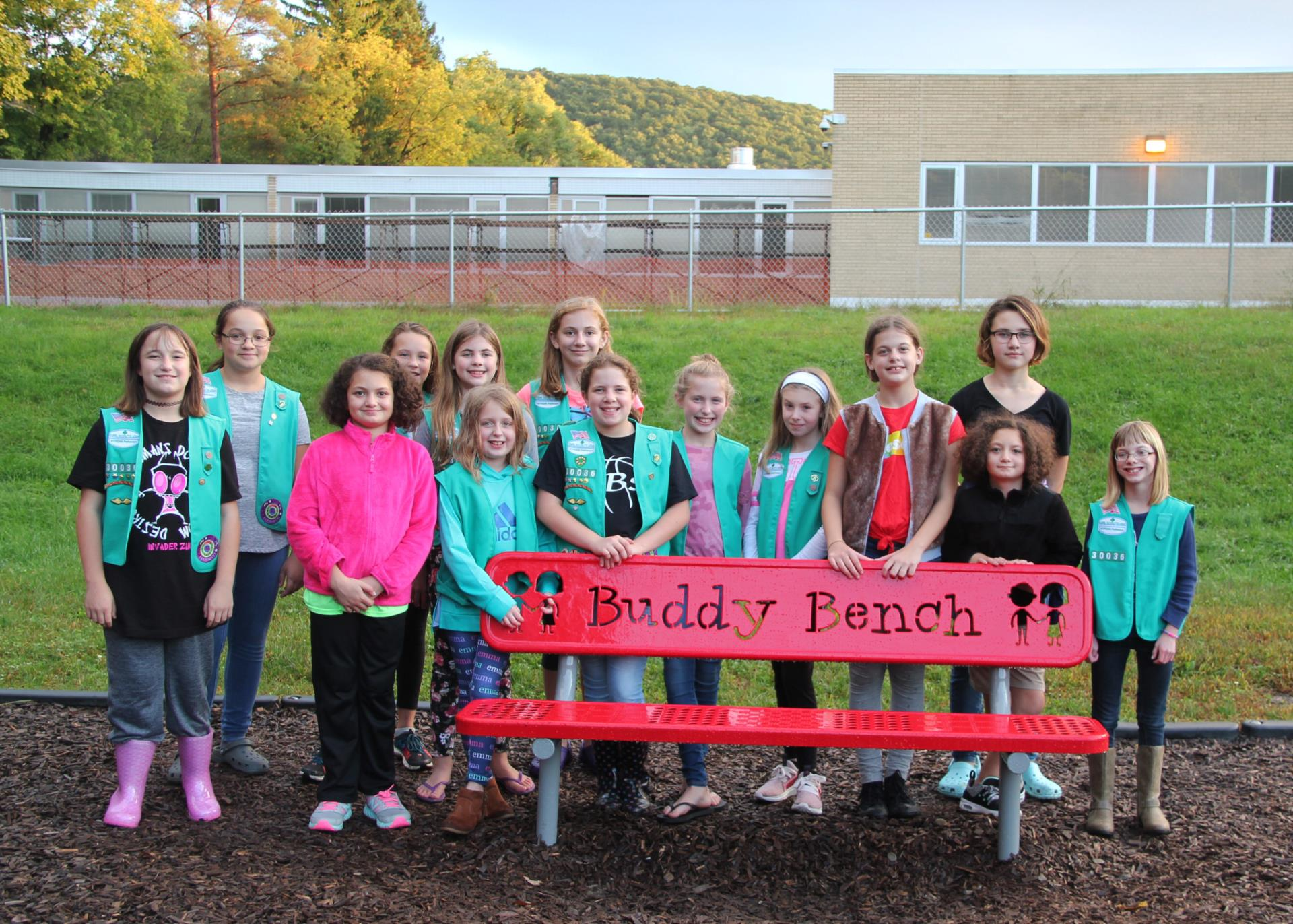 girl scout troop and buddy bench