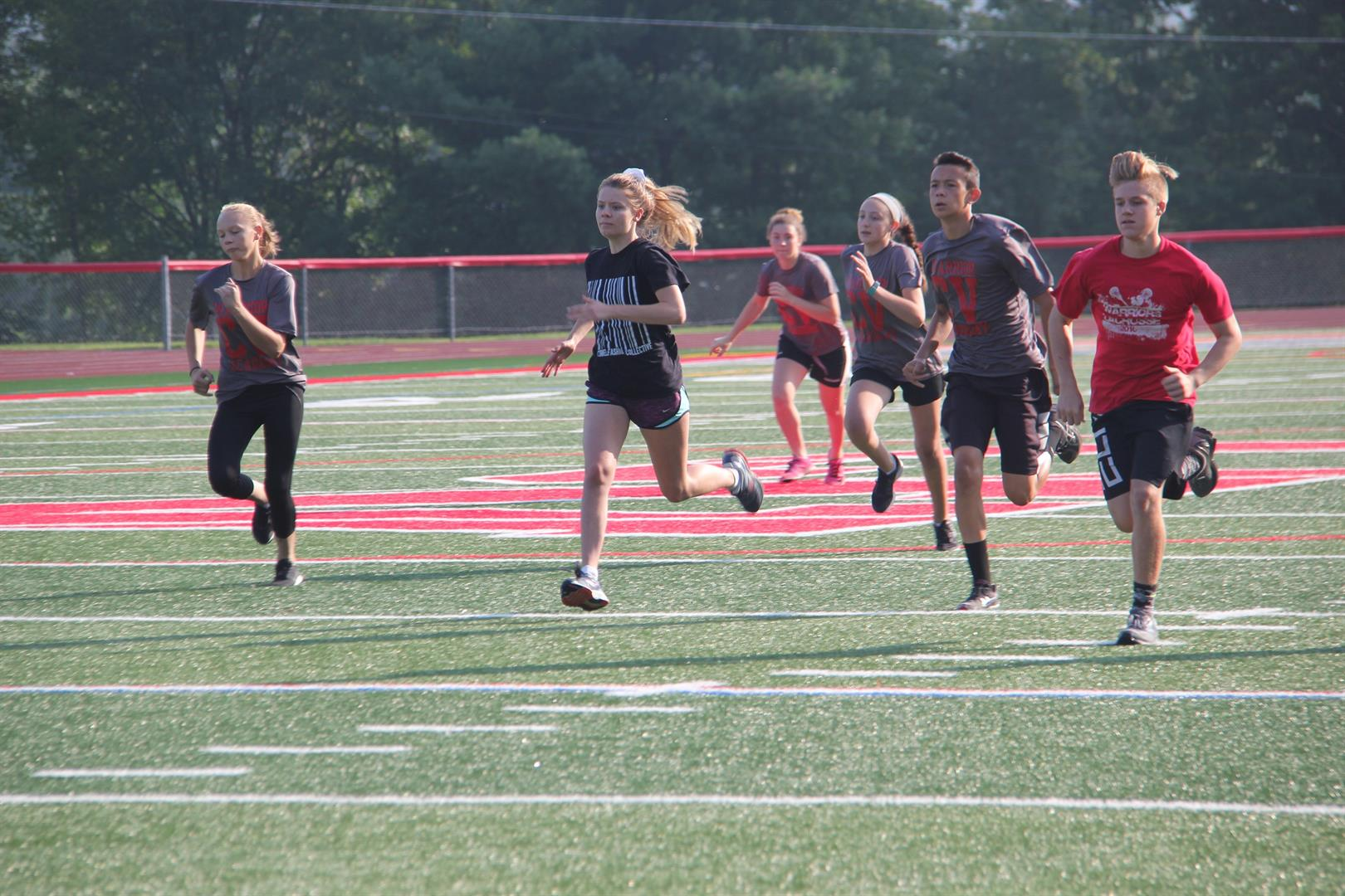 group of warrior academy students running